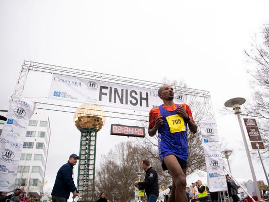 Birhanu Dare of New York via Ethiopia wins the Covenant Health Knoxville Marathon with a time of 2 hours, 24 minutes and 41 seconds on Sunday.