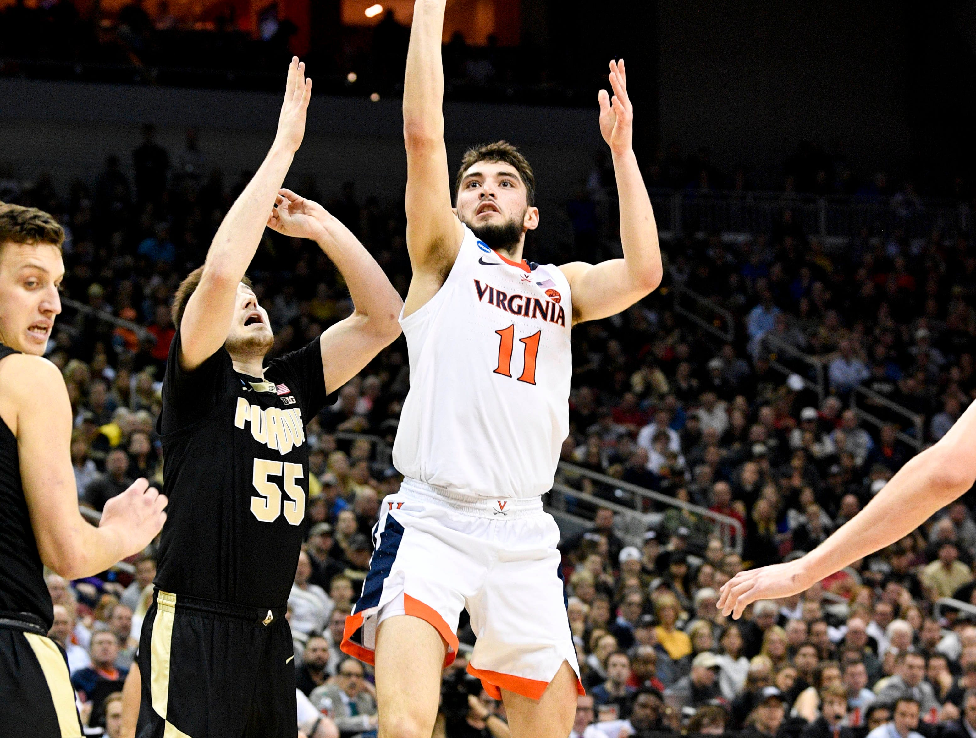 Mar 30, 2019; Louisville, KY, United States; Virginia Cavaliers guard Ty Jerome (11) shoots as Purdue Boilermakers guard Sasha Stefanovic (55) defends during the first half in the championship game of the south regional of the 2019 NCAA Tournament at KFC Yum Center. Mandatory Credit: Jamie Rhodes-USA TODAY Sports