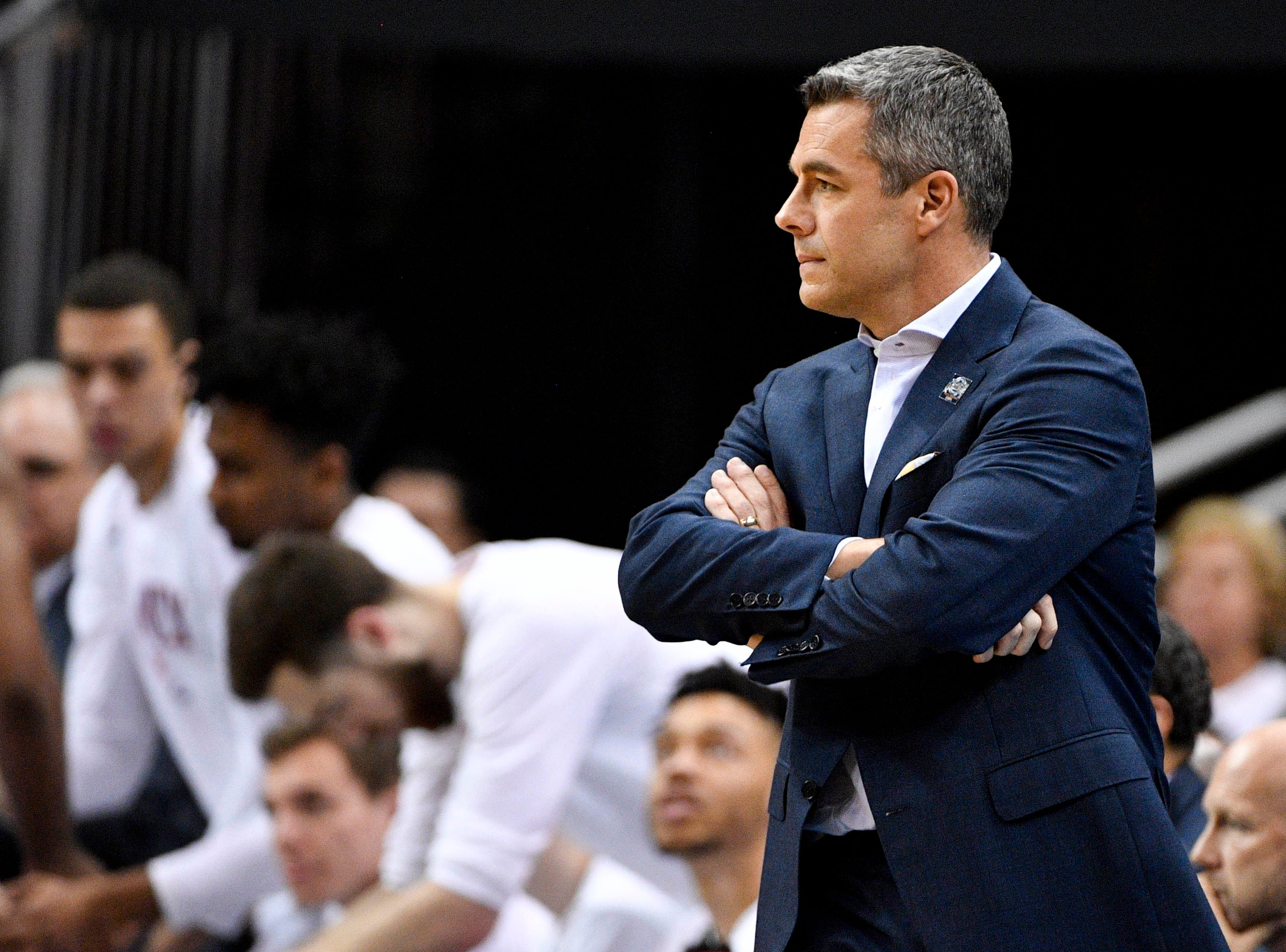 Mar 30, 2019; Louisville, KY, United States; Virginia Cavaliers head coach Tony Bennett looks on during the first half in the championship game against the Purdue Boilermakers of the south regional of the 2019 NCAA Tournament at KFC Yum Center. Mandatory Credit: Jamie Rhodes-USA TODAY Sports
