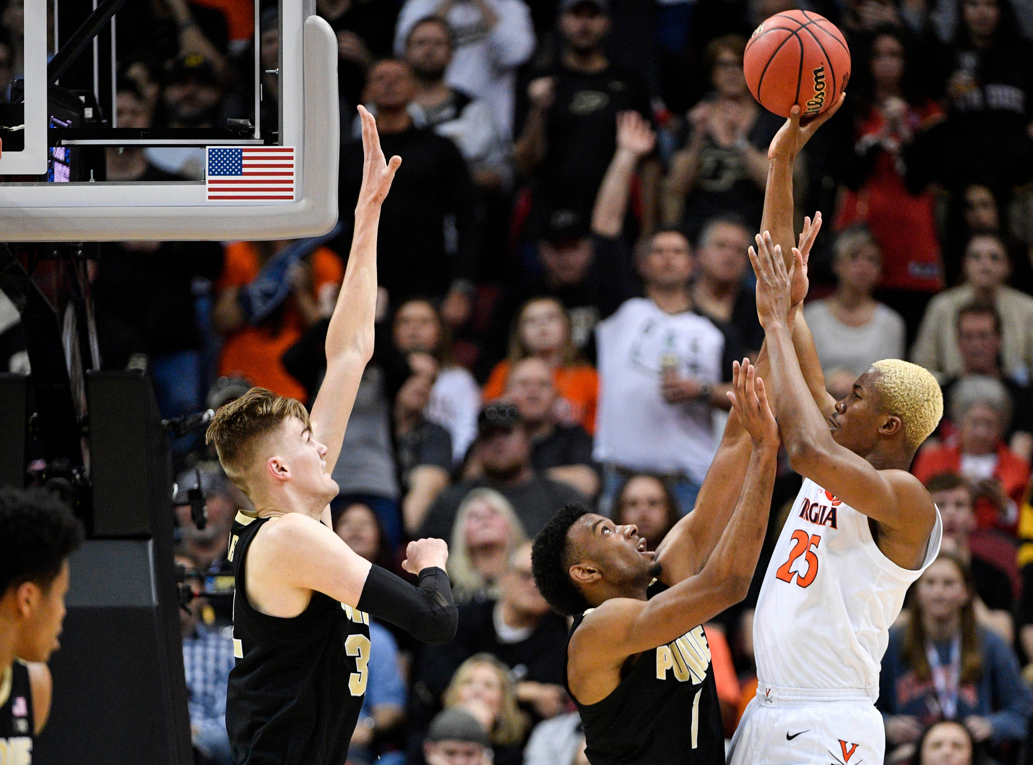 Mar 30, 2019; Louisville, KY, United States; Virginia Cavaliers forward Mamadi Diakite (25) shoots as Purdue Boilermakers forward Aaron Wheeler (1) and center Matt Haarms (32) defend during the second half in the championship game of the south regional of the 2019 NCAA Tournament at KFC Yum Center. Mandatory Credit: Jamie Rhodes-USA TODAY Sports