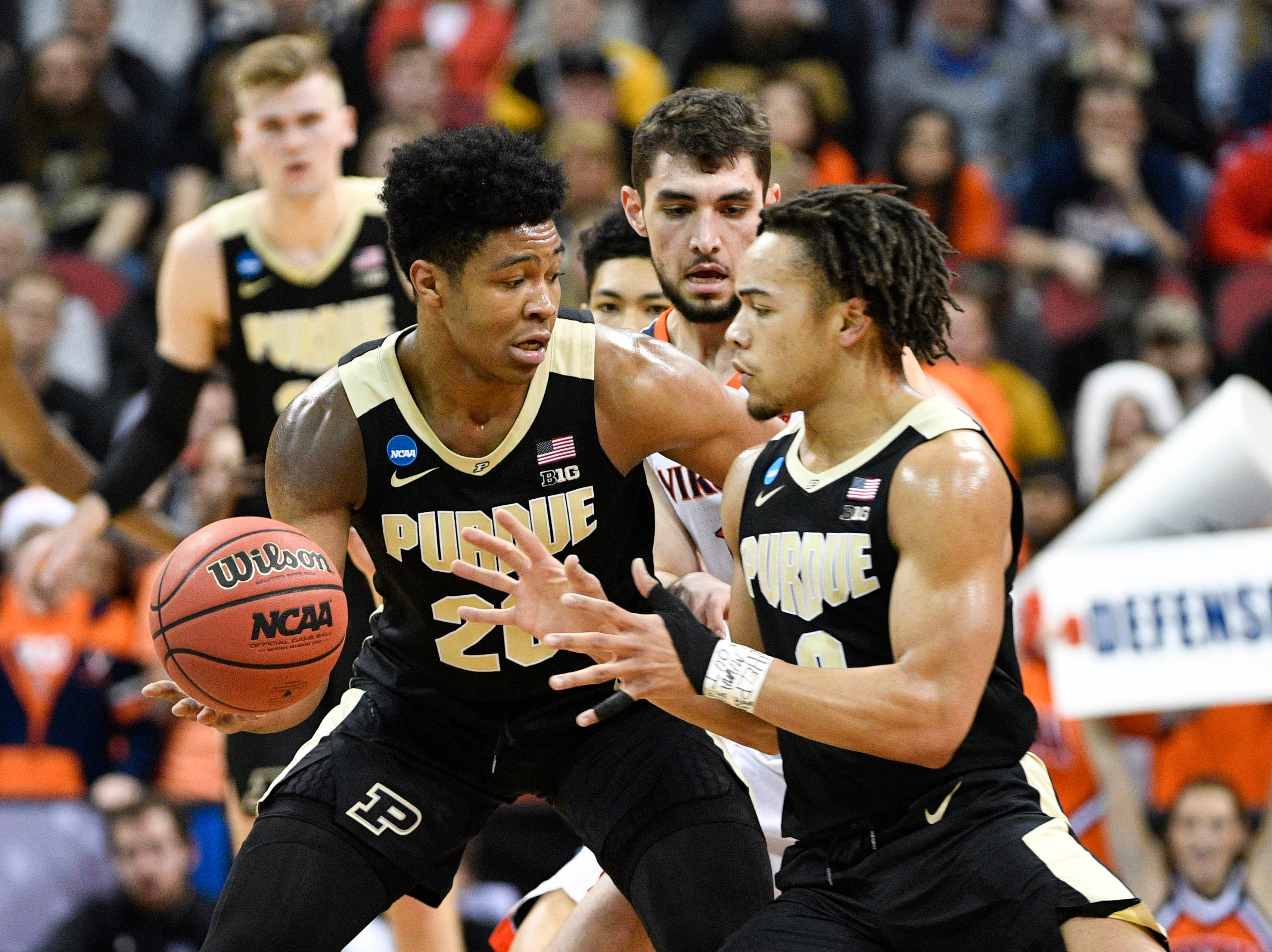Mar 30, 2019; Louisville, KY, United States; Purdue Boilermakers guard Nojel Eastern (20) passes to guard Carsen Edwards (3) during the first half in the championship game against the Virginia Cavaliers of the south regional of the 2019 NCAA Tournament at KFC Yum Center. Mandatory Credit: Jamie Rhodes-USA TODAY Sports