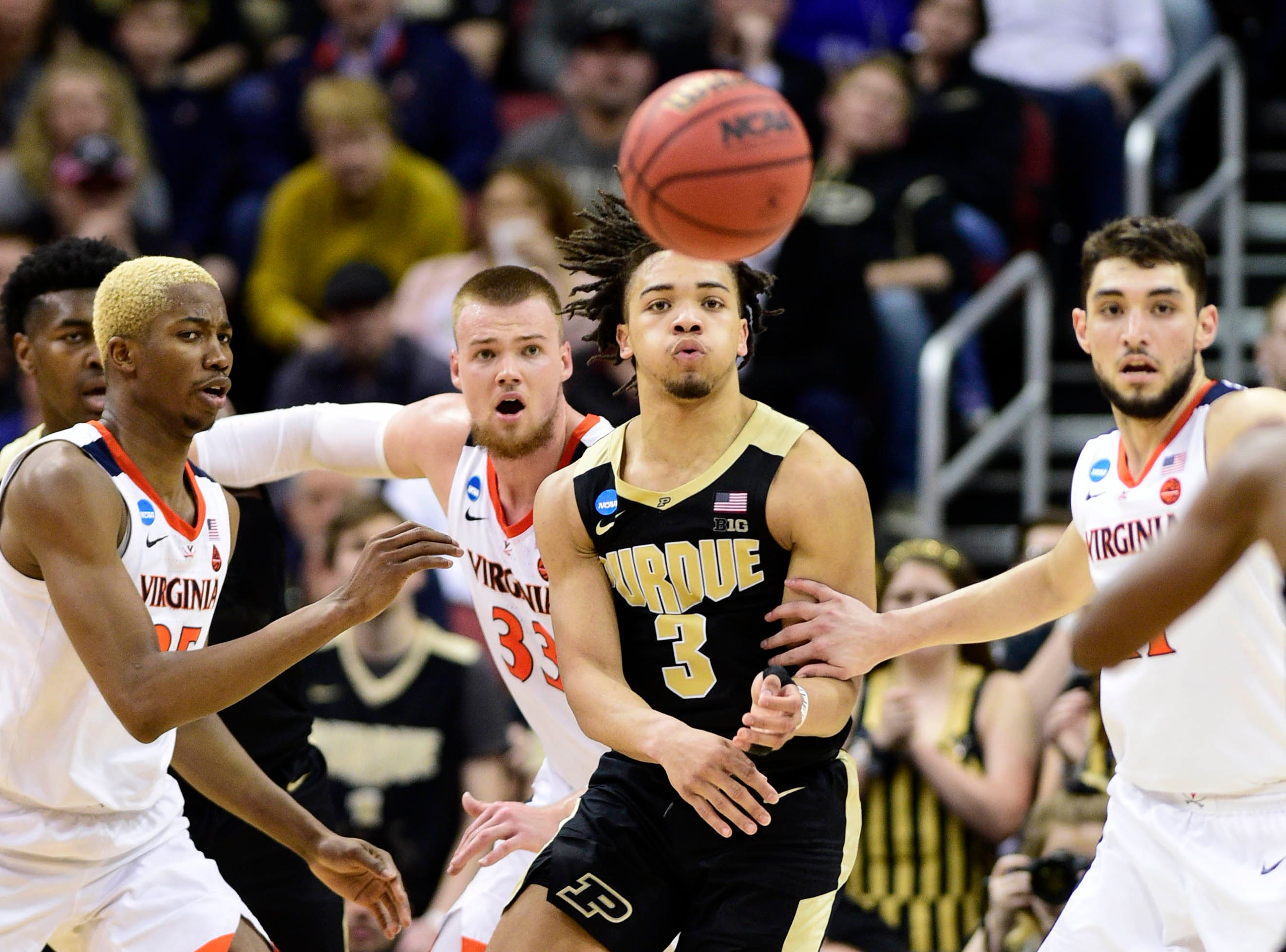 Mar 30, 2019; Louisville, KY, United States; Purdue Boilermakers guard Carsen Edwards (3) passes the ball as Virginia Cavaliers forward Mamadi Diakite (25) and center Jack Salt (33) defend during the second half in the championship game of the south regional of the 2019 NCAA Tournament at KFC Yum Center. Mandatory Credit: Thomas J. Russo-USA TODAY Sports