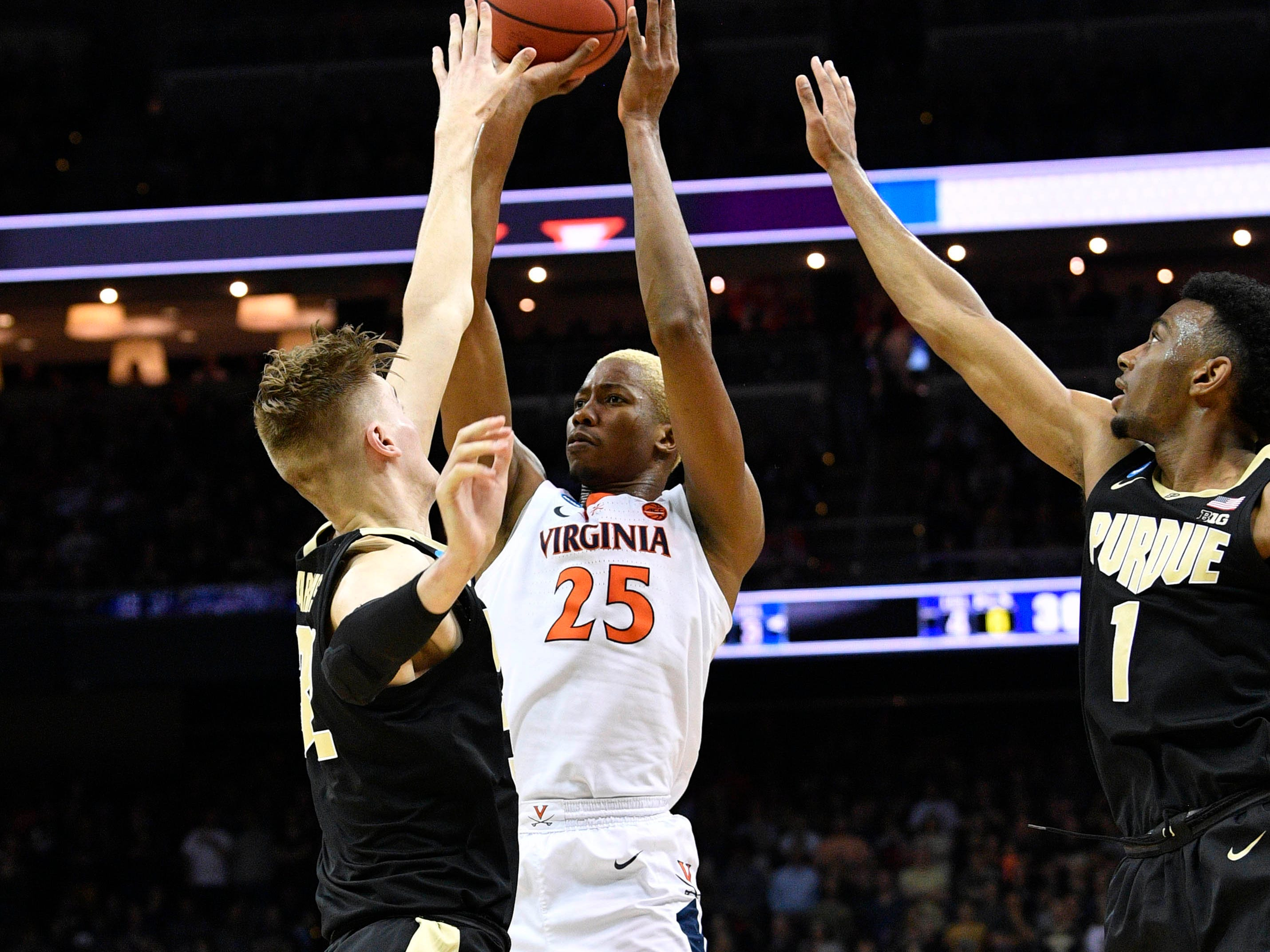 Mar 30, 2019; Louisville, KY, United States; Virginia Cavaliers forward Mamadi Diakite (25) shoots as Purdue Boilermakers center Matt Haarms (32) and forward Aaron Wheeler (1) defend during the first half in the championship game of the south regional of the 2019 NCAA Tournament at KFC Yum Center. Mandatory Credit: Jamie Rhodes-USA TODAY Sports
