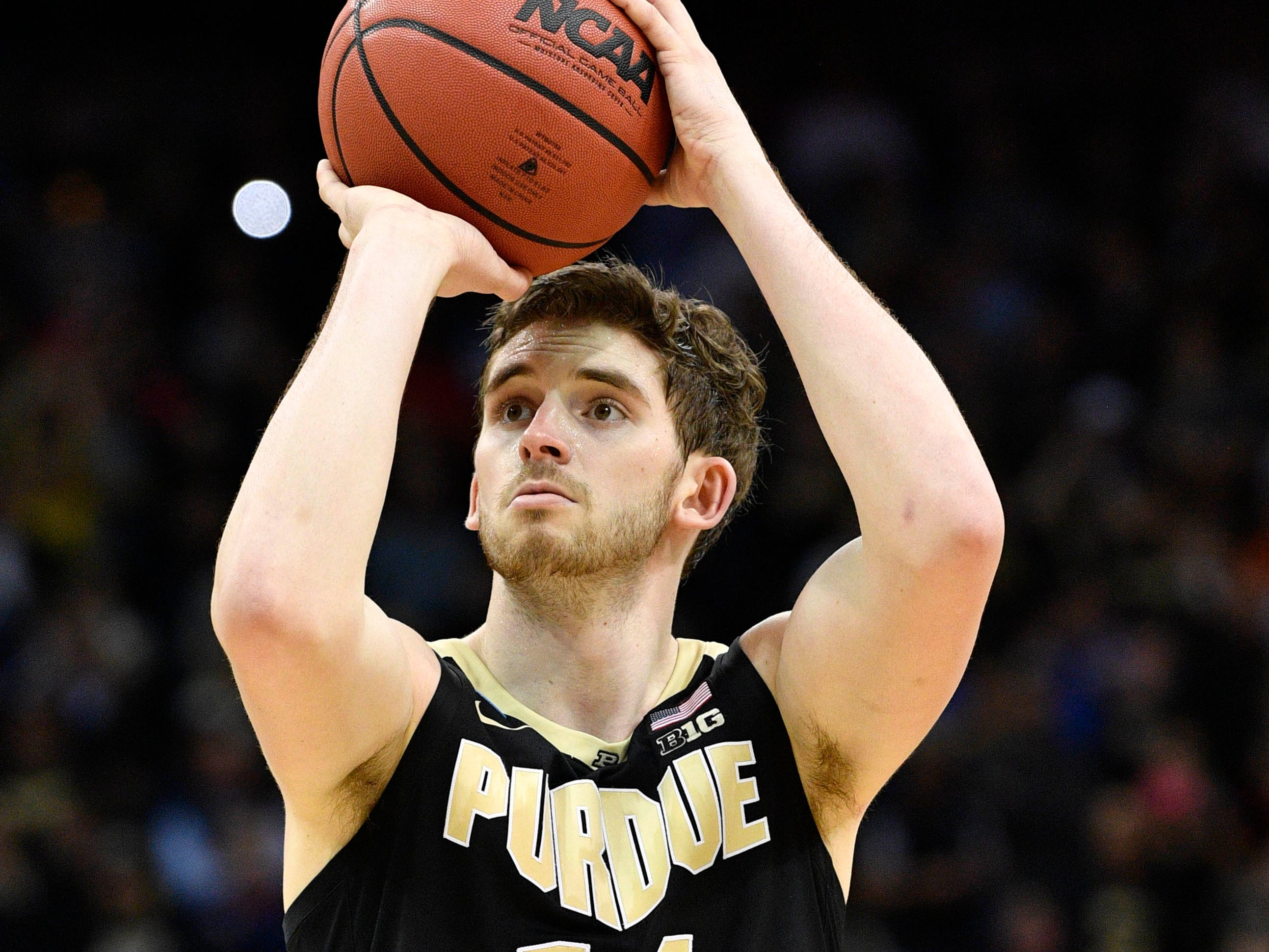 Mar 30, 2019; Louisville, KY, United States; Purdue Boilermakers guard Ryan Cline (14) shoots from the free throw line during the second half in the championship game against the Virginia Cavaliers of the south regional of the 2019 NCAA Tournament at KFC Yum Center. Mandatory Credit: Jamie Rhodes-USA TODAY Sports