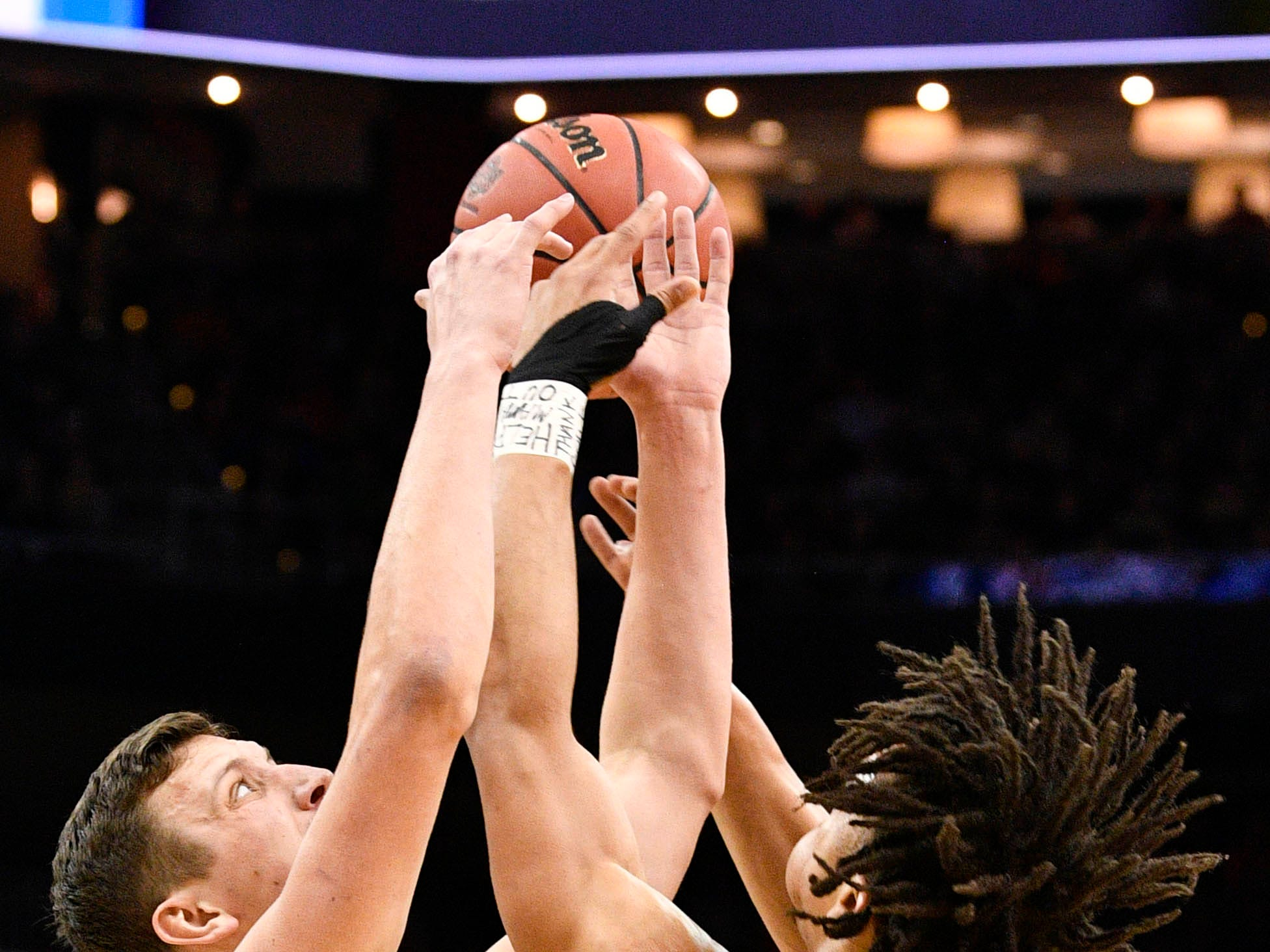 Mar 30, 2019; Louisville, KY, United States; Purdue Boilermakers forward Grady Eifert (24) and guard Carsen Edwards (3) go after the ball during the first half in the championship game against the Virginia Cavaliers of the south regional of the 2019 NCAA Tournament at KFC Yum Center. Mandatory Credit: Jamie Rhodes-USA TODAY Sports