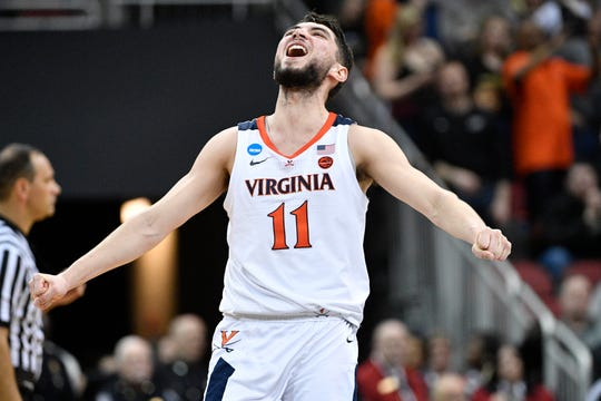 Mar 30, 2019; Louisville, KY, United States; Virginia Cavaliers guard Ty Jerome (11) reacts in overtime in the championship game against the Purdue Boilermakers of the south regional of the 2019 NCAA Tournament at KFC Yum Center. Mandatory Credit: Jamie Rhodes-USA TODAY Sports