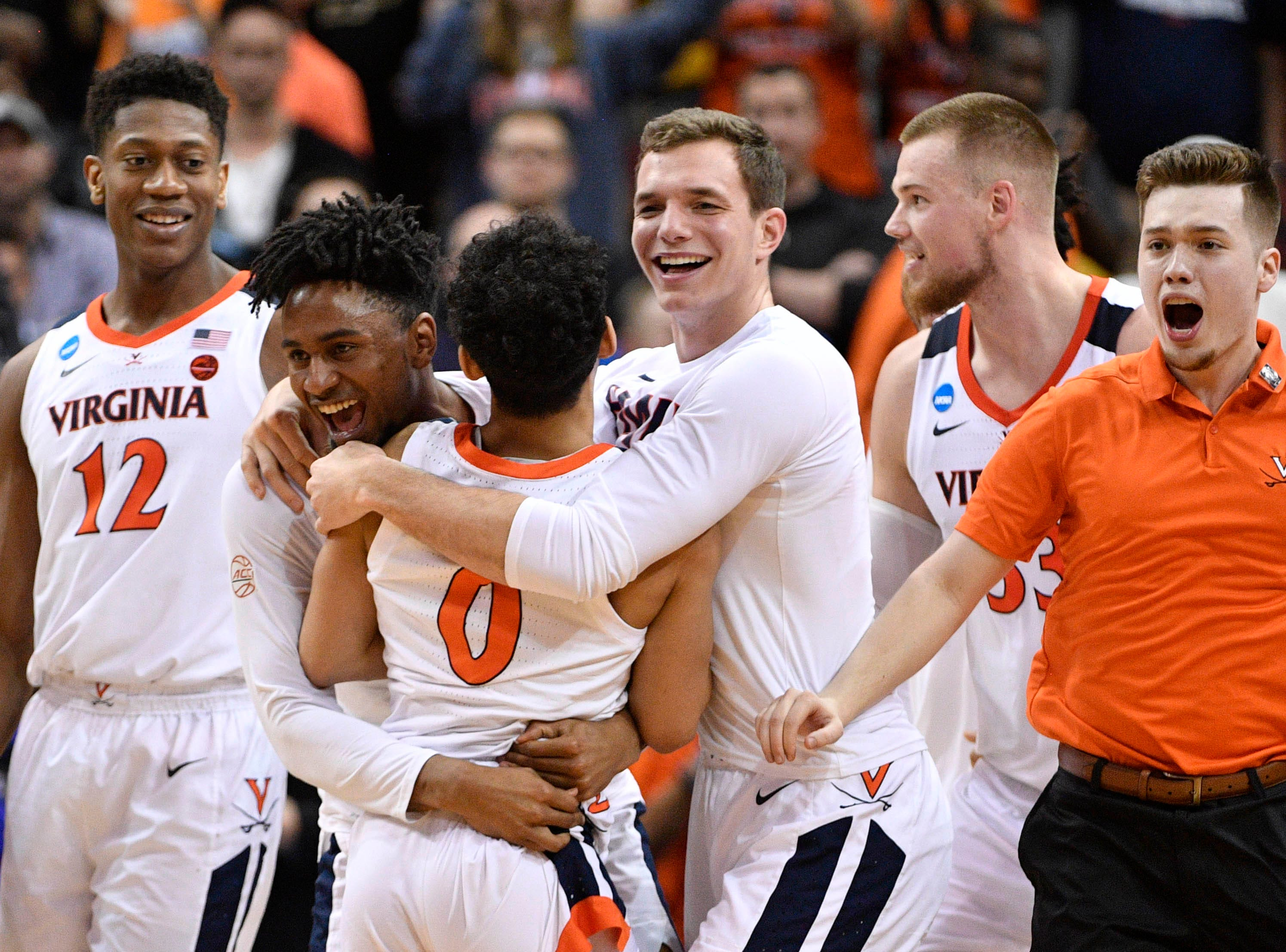 Mar 30, 2019; Louisville, KY, United States; Virginia Cavaliers guard Kihei Clark (0) and teammates celebrate the win over Purdue Boilermakers in overtime in the championship game of the south regional of the 2019 NCAA Tournament at KFC Yum Center. Mandatory Credit: Jamie Rhodes-USA TODAY Sports