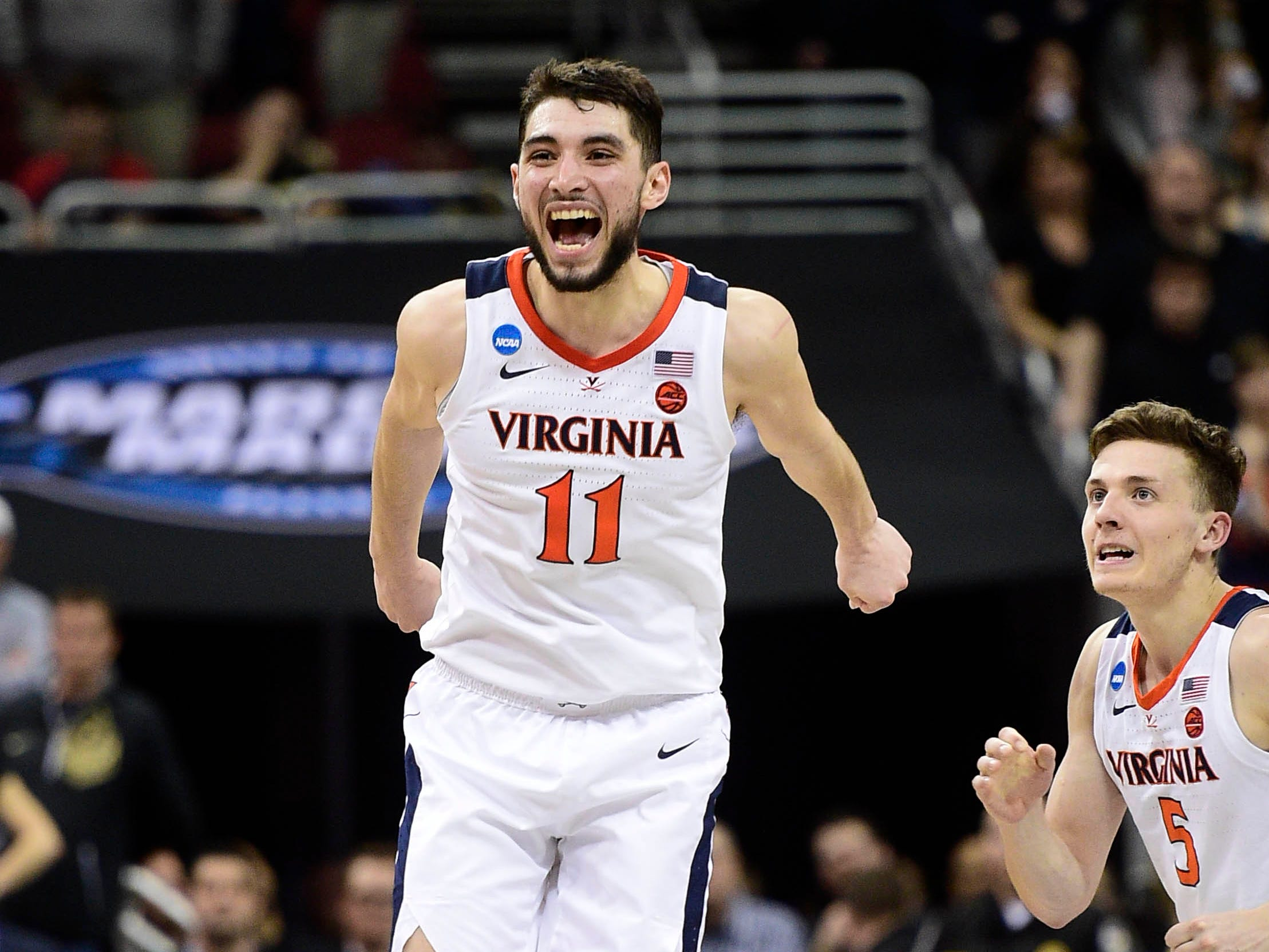 Mar 30, 2019; Louisville, KY, United States; Virginia Cavaliers guard Ty Jerome (11) celebrates with guard Kyle Guy (5) for the win over the Purdue Boilermakers in overtime in the championship game of the south regional of the 2019 NCAA Tournament at KFC Yum Center. Mandatory Credit: Thomas J. Russo-USA TODAY Sports