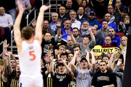 Mar 30, 2019; Louisville, KY, United States; Purdue Boilermakers fans cheer during a free throw attempt by Virginia Cavaliers guard Kyle Guy (5) during the first half in the championship game of the south regional of the 2019 NCAA Tournament at KFC Yum Center. Mandatory Credit: Thomas J. Russo-USA TODAY Sports