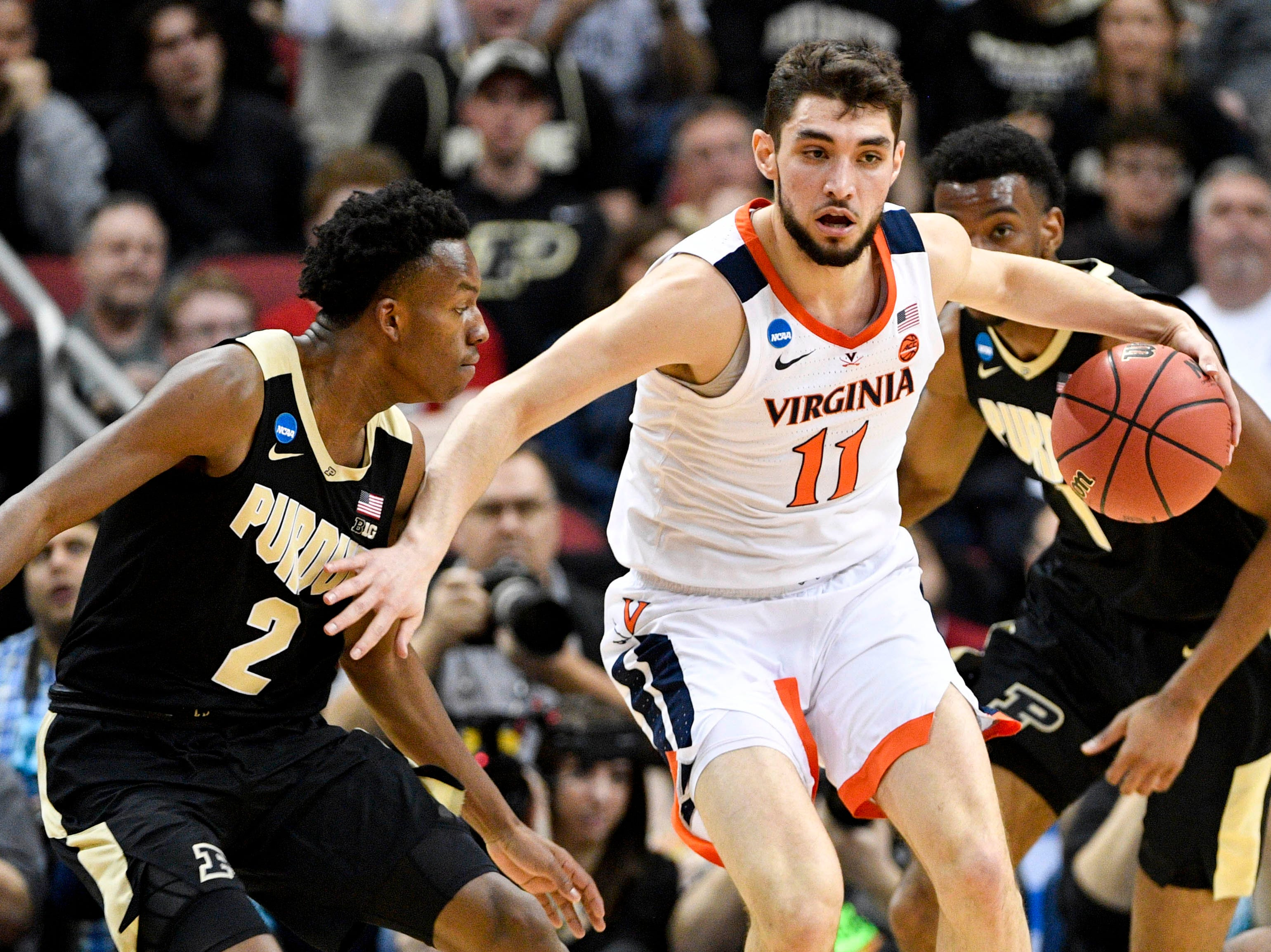 Mar 30, 2019; Louisville, KY, United States; Virginia Cavaliers guard Ty Jerome (11) works around Purdue Boilermakers guard Eric Hunter Jr. (2) during the first half in the championship game of the south regional of the 2019 NCAA Tournament at KFC Yum Center. Mandatory Credit: Jamie Rhodes-USA TODAY Sports