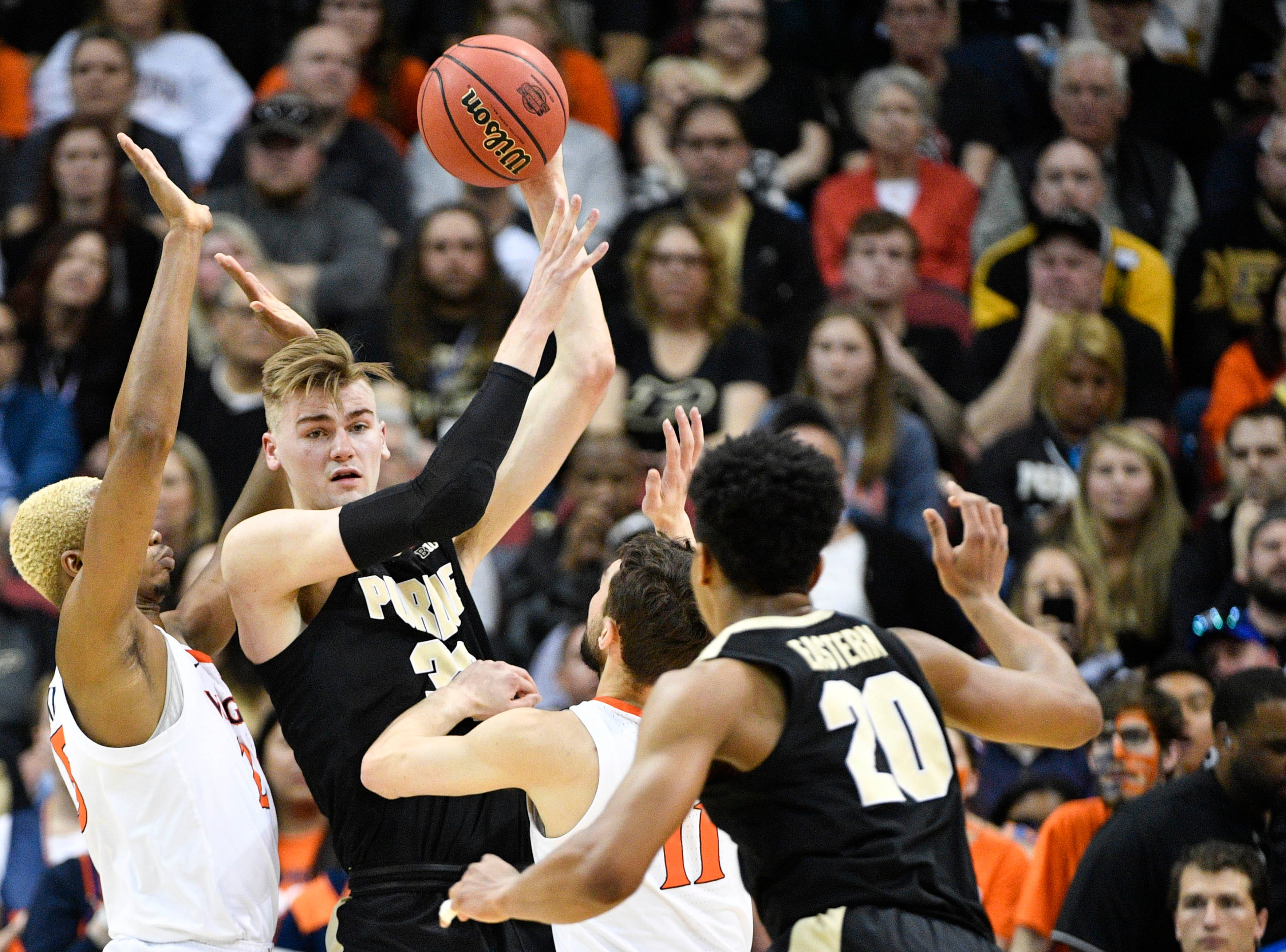 Mar 30, 2019; Louisville, KY, United States; Purdue Boilermakers center Matt Haarms (32) looks to pass to guard Nojel Eastern (20) as Virginia Cavaliers guard Ty Jerome (11) and forward Mamadi Diakite (25) defend during the first half in the championship game of the south regional of the 2019 NCAA Tournament at KFC Yum Center. Mandatory Credit: Jamie Rhodes-USA TODAY Sports