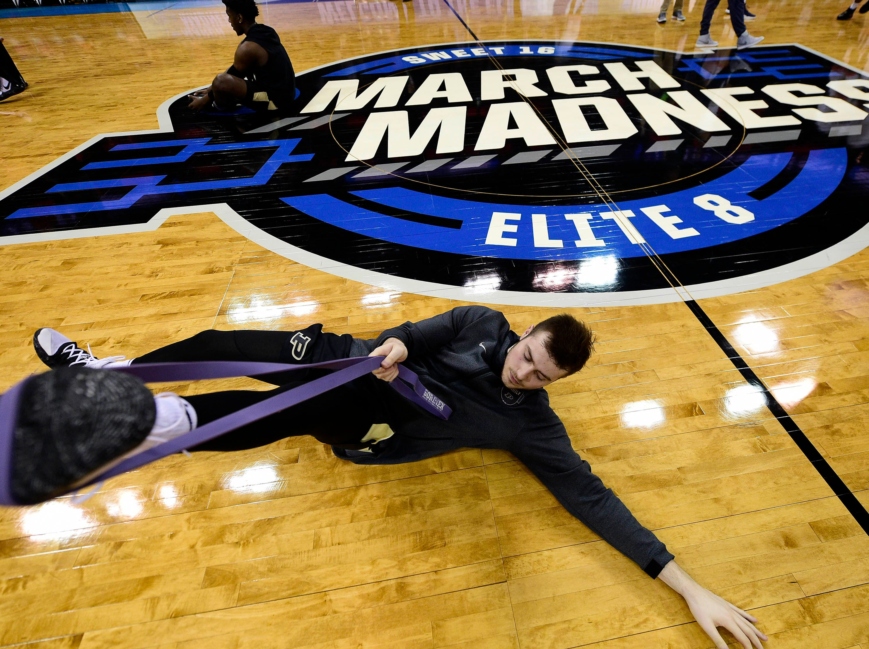 Mar 30, 2019; Louisville, KY, United States; Purdue Boilermakers guard Sasha Stefanovic (55) stretches for the championship game against the Virginia Cavaliers of the south regional of the 2019 NCAA Tournament at KFC Yum Center. Mandatory Credit: Thomas J. Russo-USA TODAY Sports