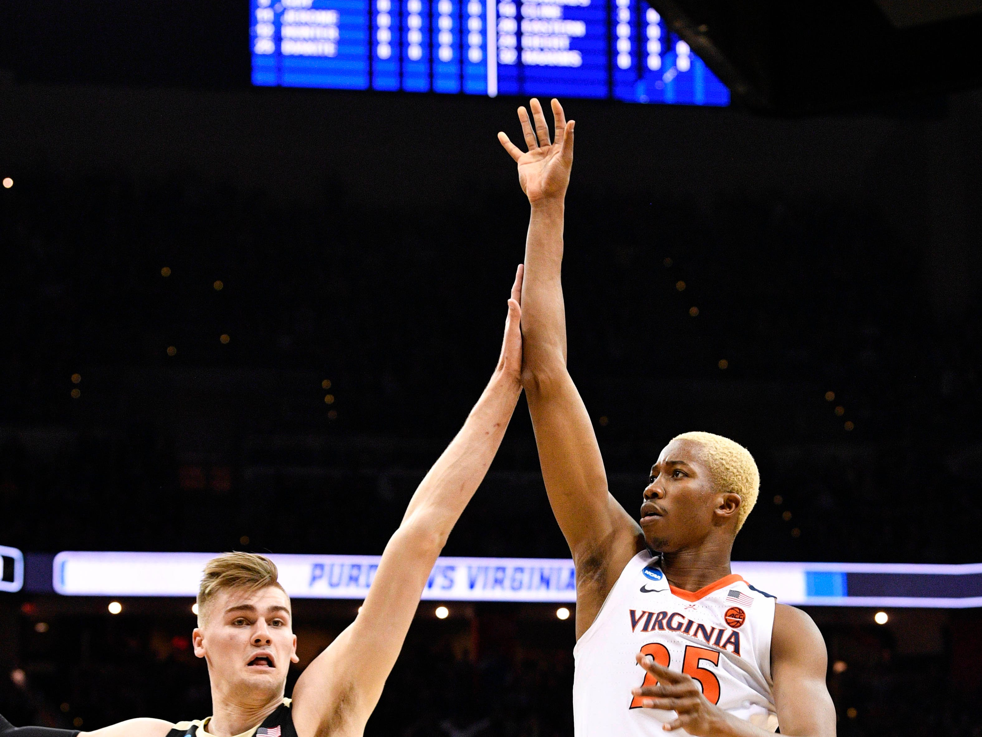 Mar 30, 2019; Louisville, KY, United States; Virginia Cavaliers forward Mamadi Diakite (25) shoots as Purdue Boilermakers center Matt Haarms (32) defends during the first half in the championship game of the south regional of the 2019 NCAA Tournament at KFC Yum Center. Mandatory Credit: Jamie Rhodes-USA TODAY Sports