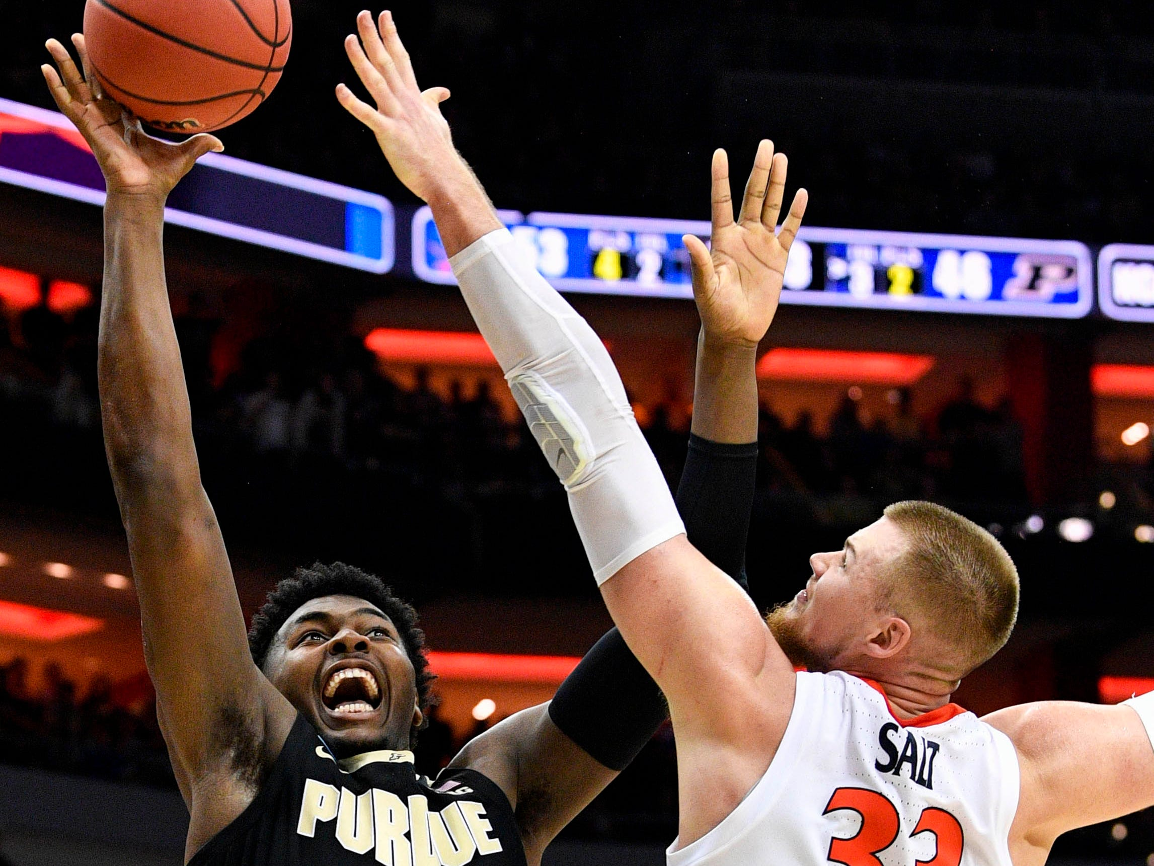 Mar 30, 2019; Louisville, KY, United States; Purdue Boilermakers forward Trevion Williams (50) goes up for a shot as Virginia Cavaliers center Jack Salt (33) defends during the second half in the championship game of the south regional of the 2019 NCAA Tournament at KFC Yum Center. Mandatory Credit: Jamie Rhodes-USA TODAY Sports