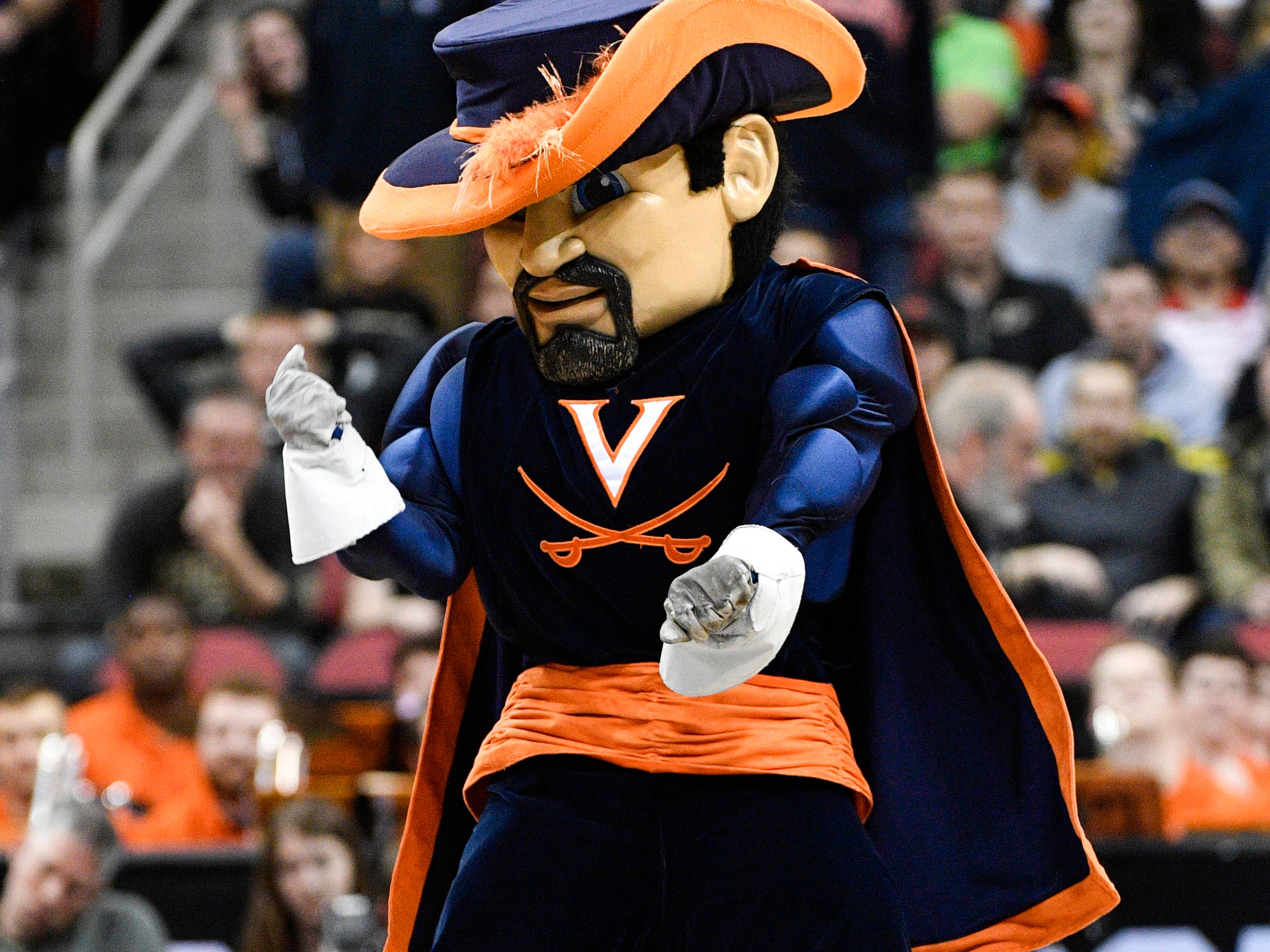 Mar 30, 2019; Louisville, KY, United States; Virginia Cavaliers mascot performs during the first half in the championship game against the Purdue Boilermakers of the south regional of the 2019 NCAA Tournament at KFC Yum Center. Mandatory Credit: Jamie Rhodes-USA TODAY Sports