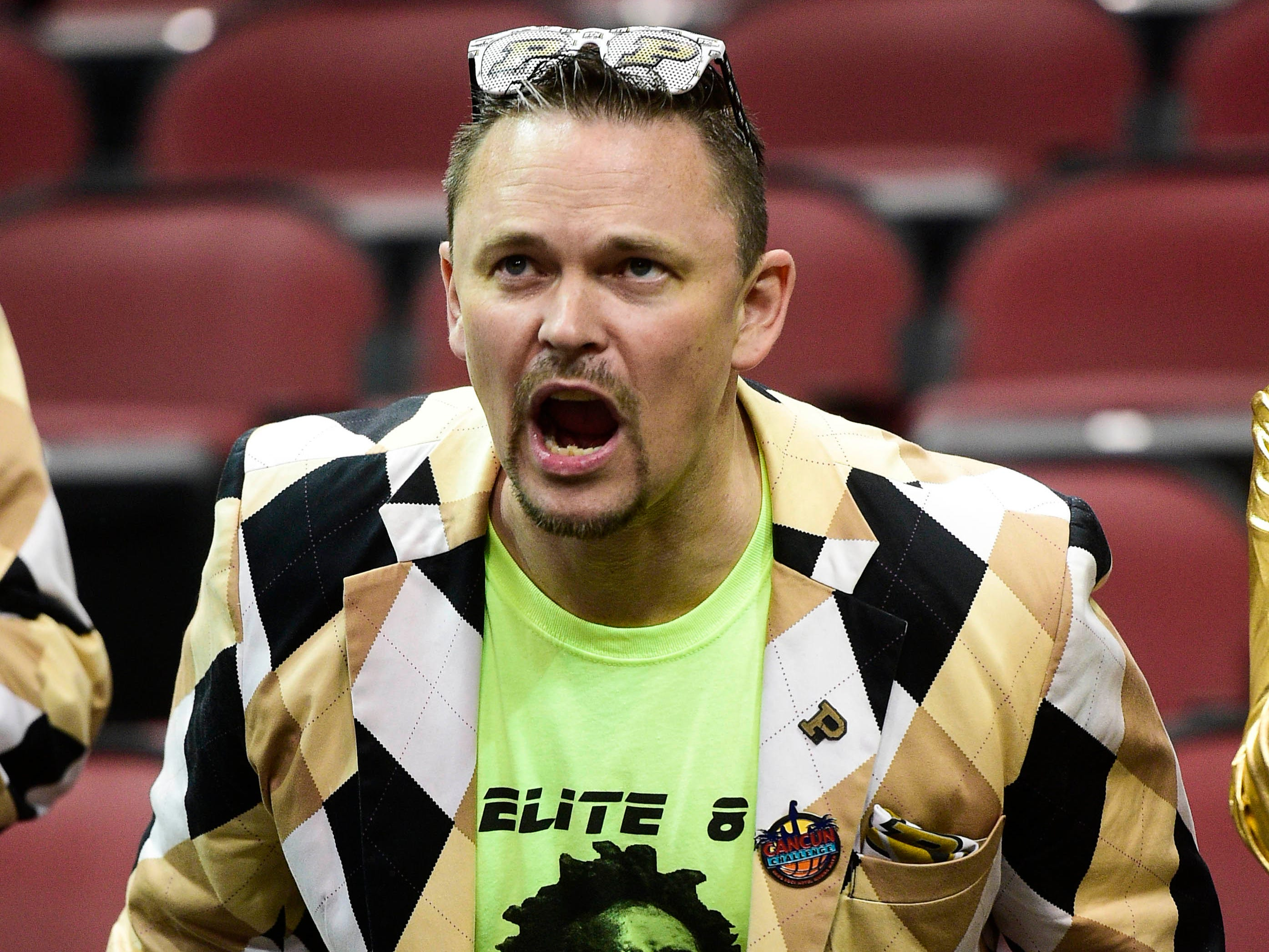 Mar 30, 2019; Louisville, KY, United States; A Purdue Boilermakers fan cheers before the championship game against the Virginia Cavaliers of the south regional of the 2019 NCAA Tournament at KFC Yum Center. Mandatory Credit: Thomas J. Russo-USA TODAY Sports