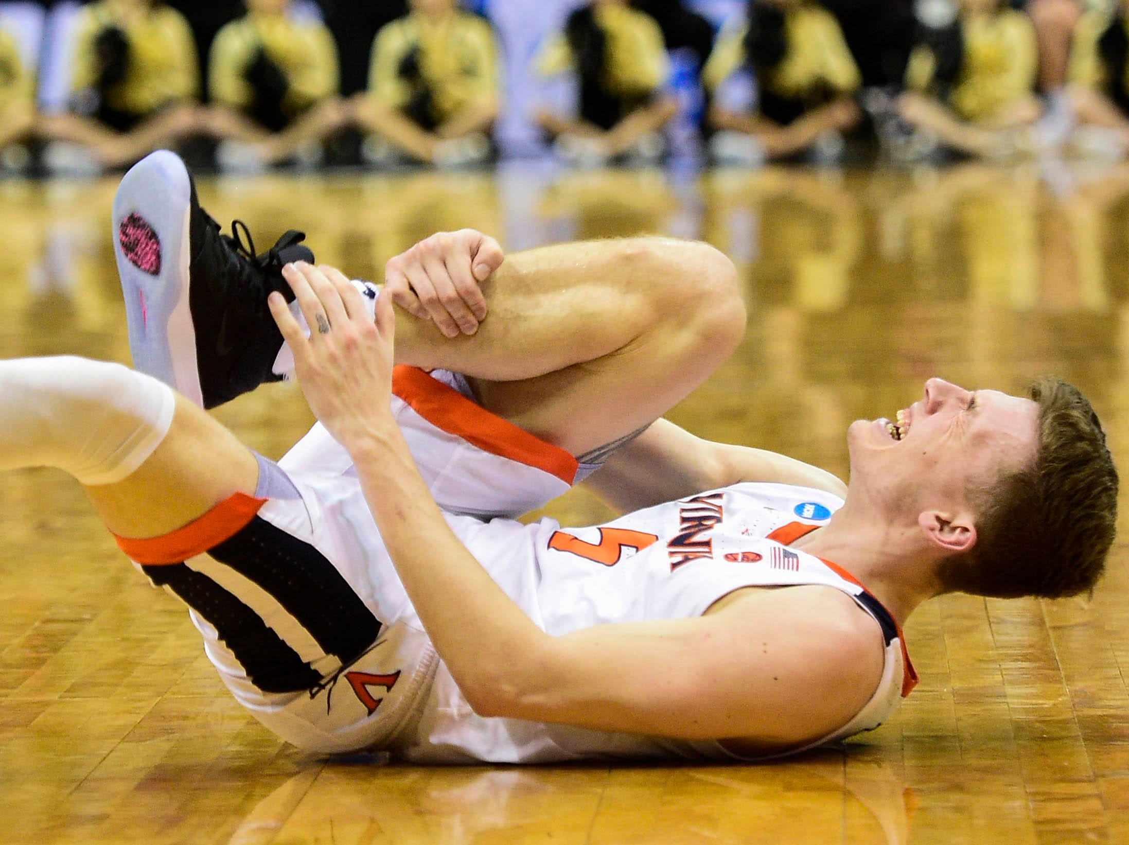 Mar 30, 2019; Louisville, KY, United States; Virginia Cavaliers guard Kyle Guy (5) reacts while holding his leg during the first half in the championship game against the Purdue Boilermakers of the south regional of the 2019 NCAA Tournament at KFC Yum Center. Mandatory Credit: Thomas J. Russo-USA TODAY Sports