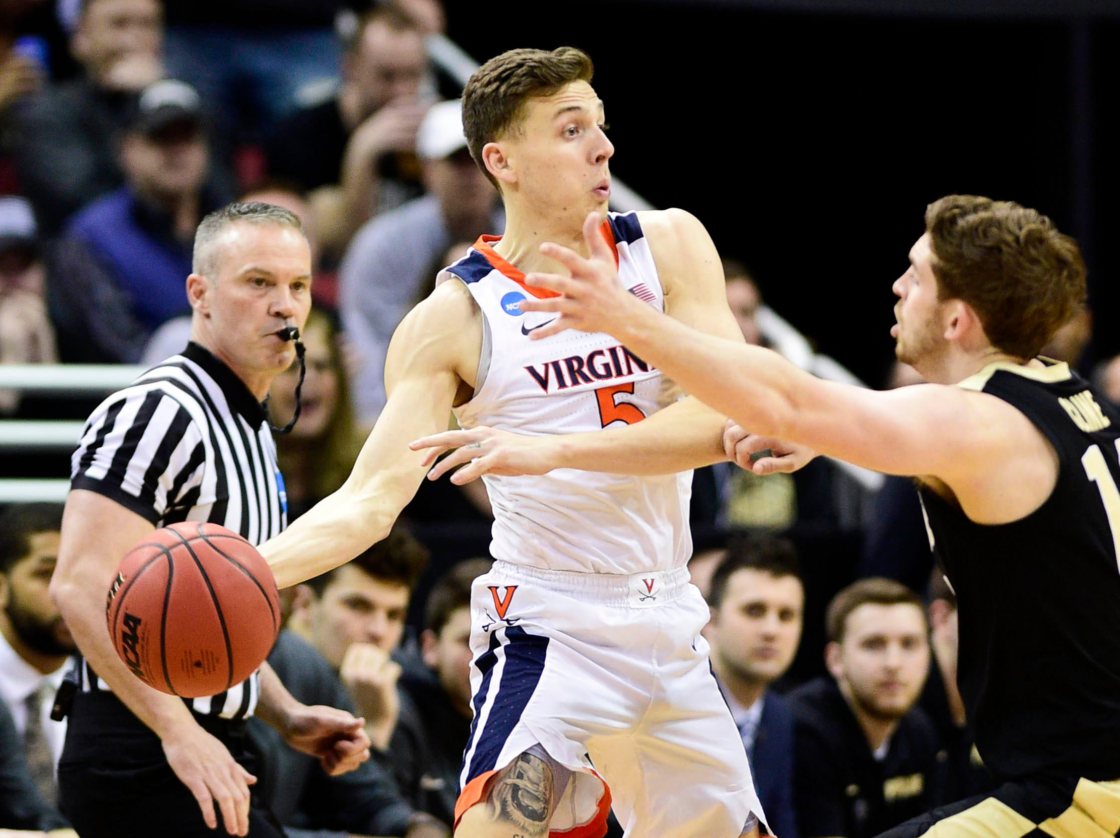 Mar 30, 2019; Louisville, KY, United States; Virginia Cavaliers guard Kyle Guy (5) works around the defense of Purdue Boilermakers guard Ryan Cline (14) during the first half in the championship game of the south regional of the 2019 NCAA Tournament at KFC Yum Center. Mandatory Credit: Thomas J. Russo-USA TODAY Sports