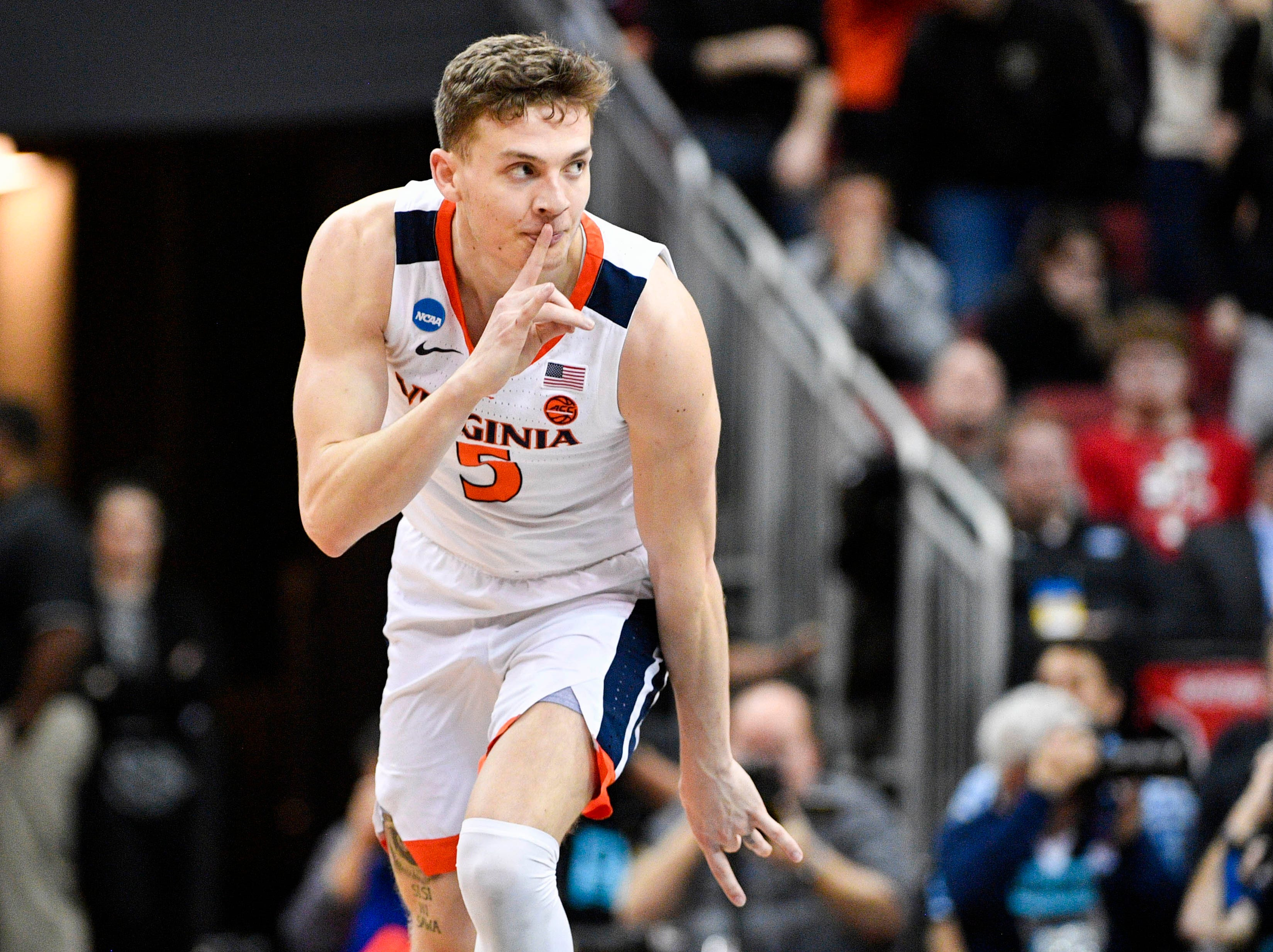 Mar 30, 2019; Louisville, KY, United States; Virginia Cavaliers guard Kyle Guy (5) reacts during the second half in the championship game against the Purdue Boilermakers of the south regional of the 2019 NCAA Tournament at KFC Yum Center. Mandatory Credit: Jamie Rhodes-USA TODAY Sports
