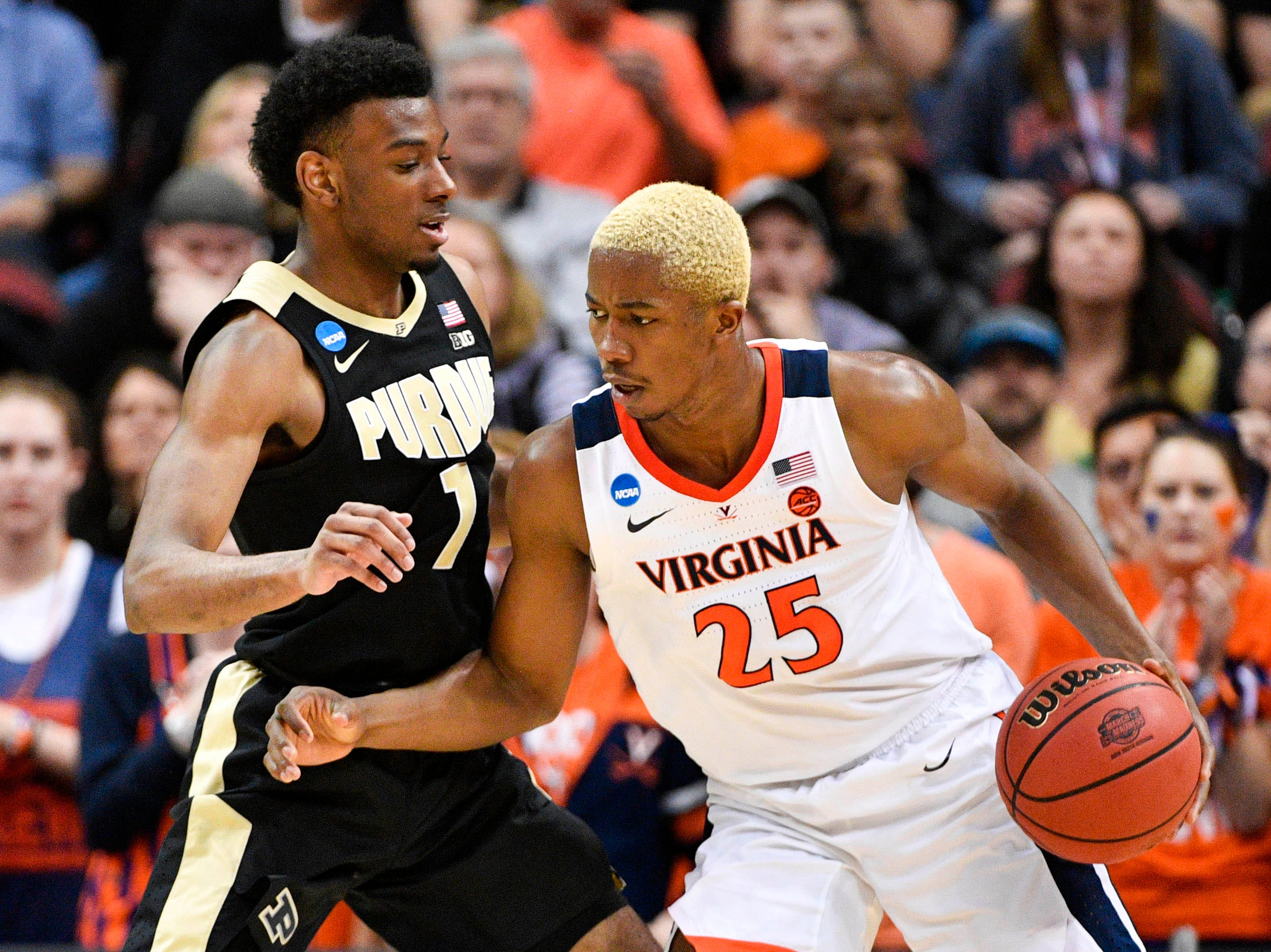 Mar 30, 2019; Louisville, KY, United States; Virginia Cavaliers forward Mamadi Diakite (25) works around Purdue Boilermakers forward Aaron Wheeler (1) during the second half in the championship game of the south regional of the 2019 NCAA Tournament at KFC Yum Center. Mandatory Credit: Jamie Rhodes-USA TODAY Sports