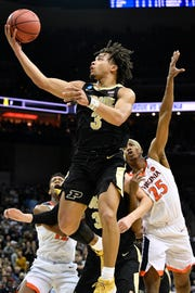 Mar 30, 2019; Louisville, KY, United States; Purdue Boilermakers guard Carsen Edwards (3) goes up for a shot as Virginia Cavaliers forward Mamadi Diakite (25) defends during the second half in the championship game of the south regional of the 2019 NCAA Tournament at KFC Yum Center. Mandatory Credit: Jamie Rhodes-USA TODAY Sports