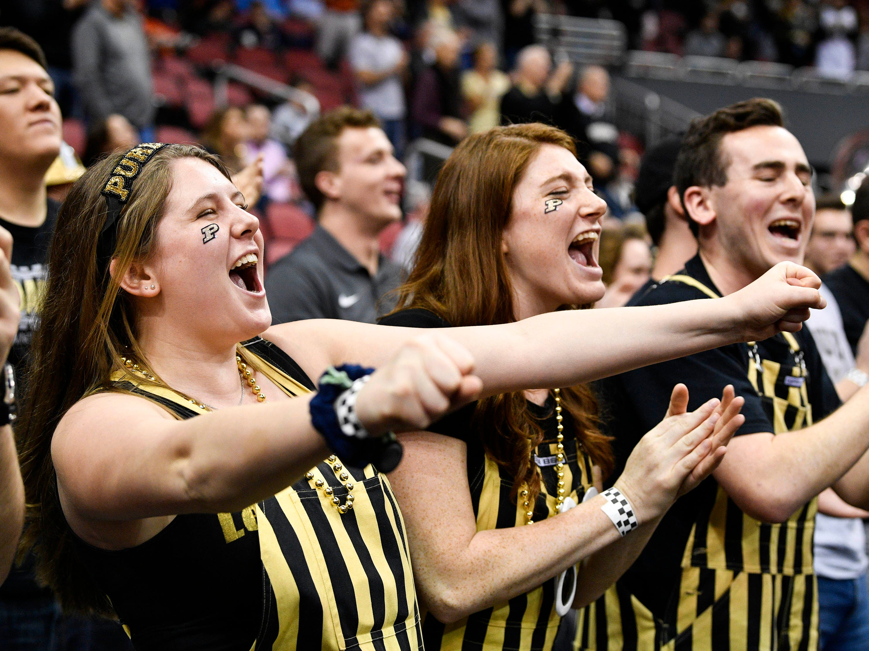 Mar 30, 2019; Louisville, KY, United States; Purdue Boilermakers fans cheer before the championship game against the Virginia Cavaliers of the south regional of the 2019 NCAA Tournament at KFC Yum Center. Mandatory Credit: Jamie Rhodes-USA TODAY Sports