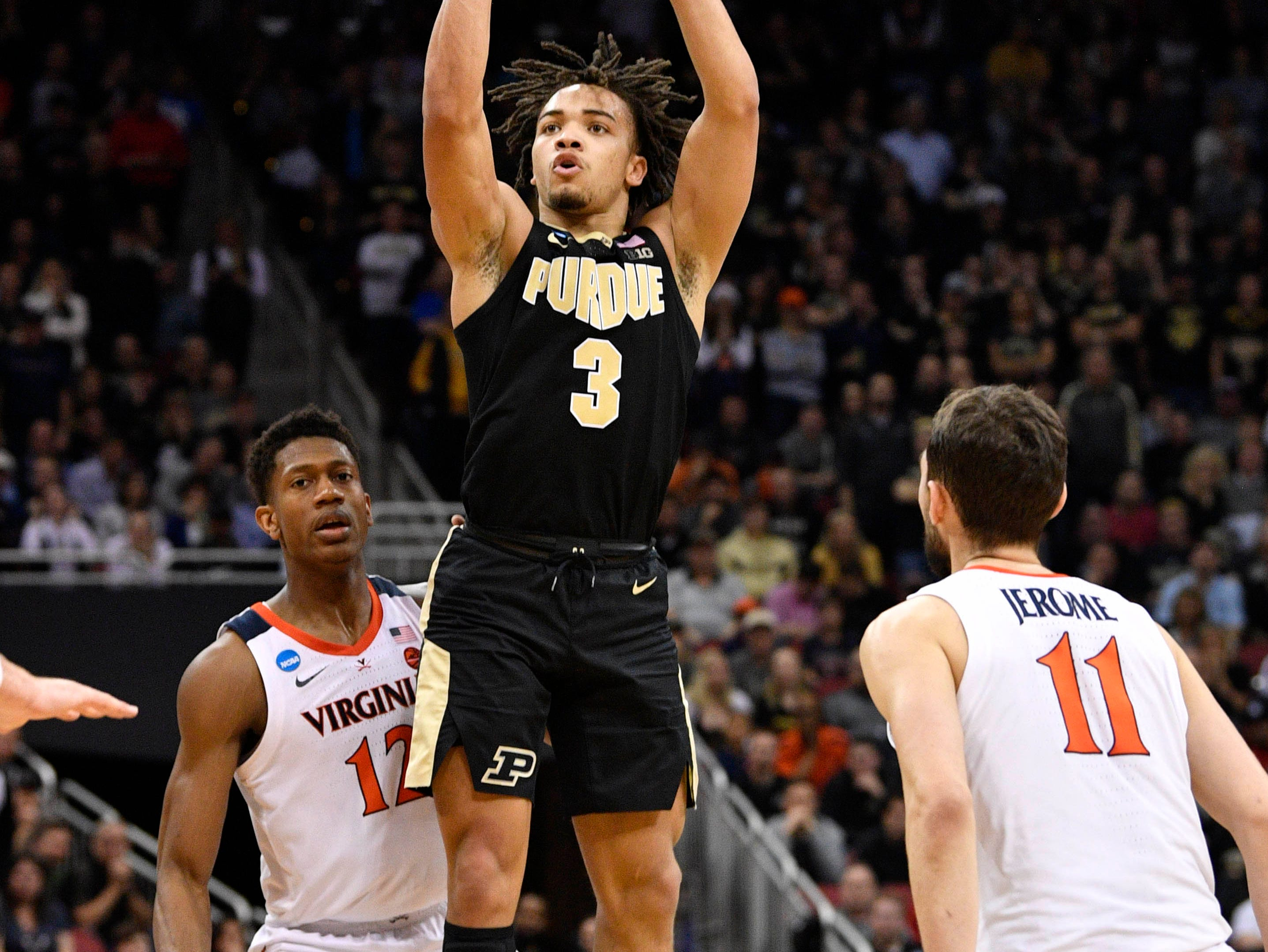 Mar 30, 2019; Louisville, KY, United States; Purdue Boilermakers guard Carsen Edwards (3) shoots over Virginia Cavaliers guard De'Andre Hunter (12) and guard Ty Jerome (11) during the second half in the championship game of the south regional of the 2019 NCAA Tournament at KFC Yum Center. Mandatory Credit: Jamie Rhodes-USA TODAY Sports