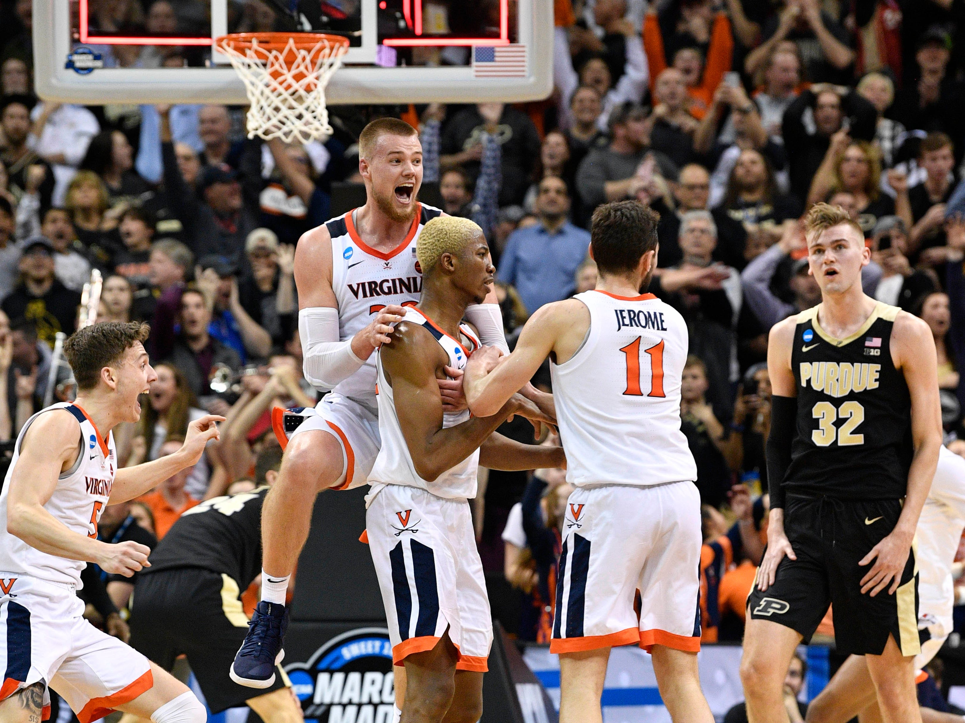 Mar 30, 2019; Louisville, KY, United States; Virginia Cavaliers forward Mamadi Diakite (25) reacts with center Jack Salt (33) and guard Ty Jerome (11) as Purdue Boilermakers center Matt Haarms (32) looks on when the game is tied during the second half in the championship game of the south regional of the 2019 NCAA Tournament at KFC Yum Center. Mandatory Credit: Jamie Rhodes-USA TODAY Sports