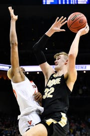 Mar 30, 2019; Louisville, KY, United States; Purdue Boilermakers center Matt Haarms (32) shoots as Virginia Cavaliers forward Mamadi Diakite (25) defends during overtime in the championship game of the south regional of the 2019 NCAA Tournament at KFC Yum Center. Mandatory Credit: Jamie Rhodes-USA TODAY Sports