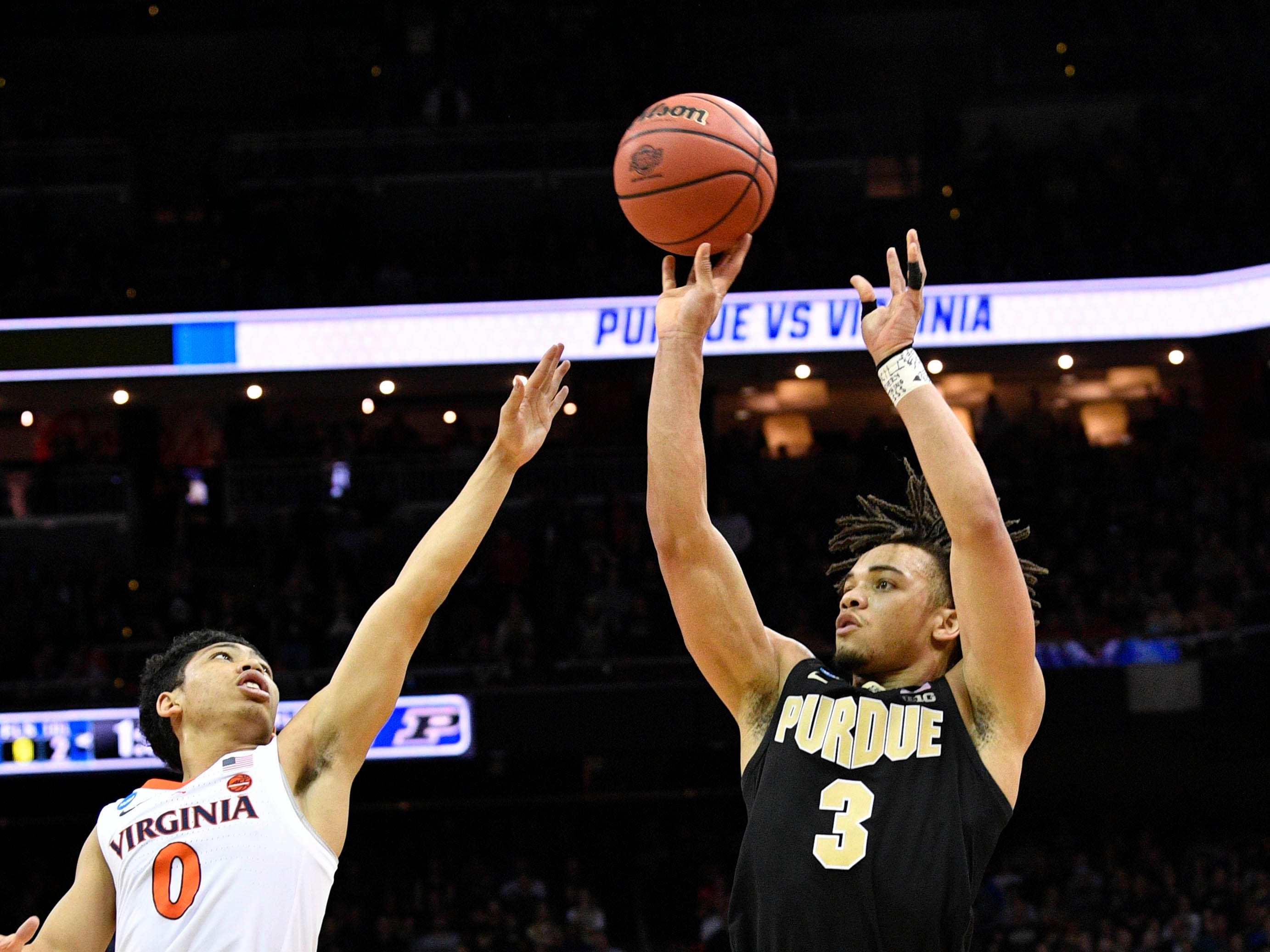 Mar 30, 2019; Louisville, KY, United States; Purdue Boilermakers guard Carsen Edwards (3) shoots as Virginia Cavaliers guard Kihei Clark (0) defends during overtime in the championship game of the south regional of the 2019 NCAA Tournament at KFC Yum Center. Mandatory Credit: Jamie Rhodes-USA TODAY Sports