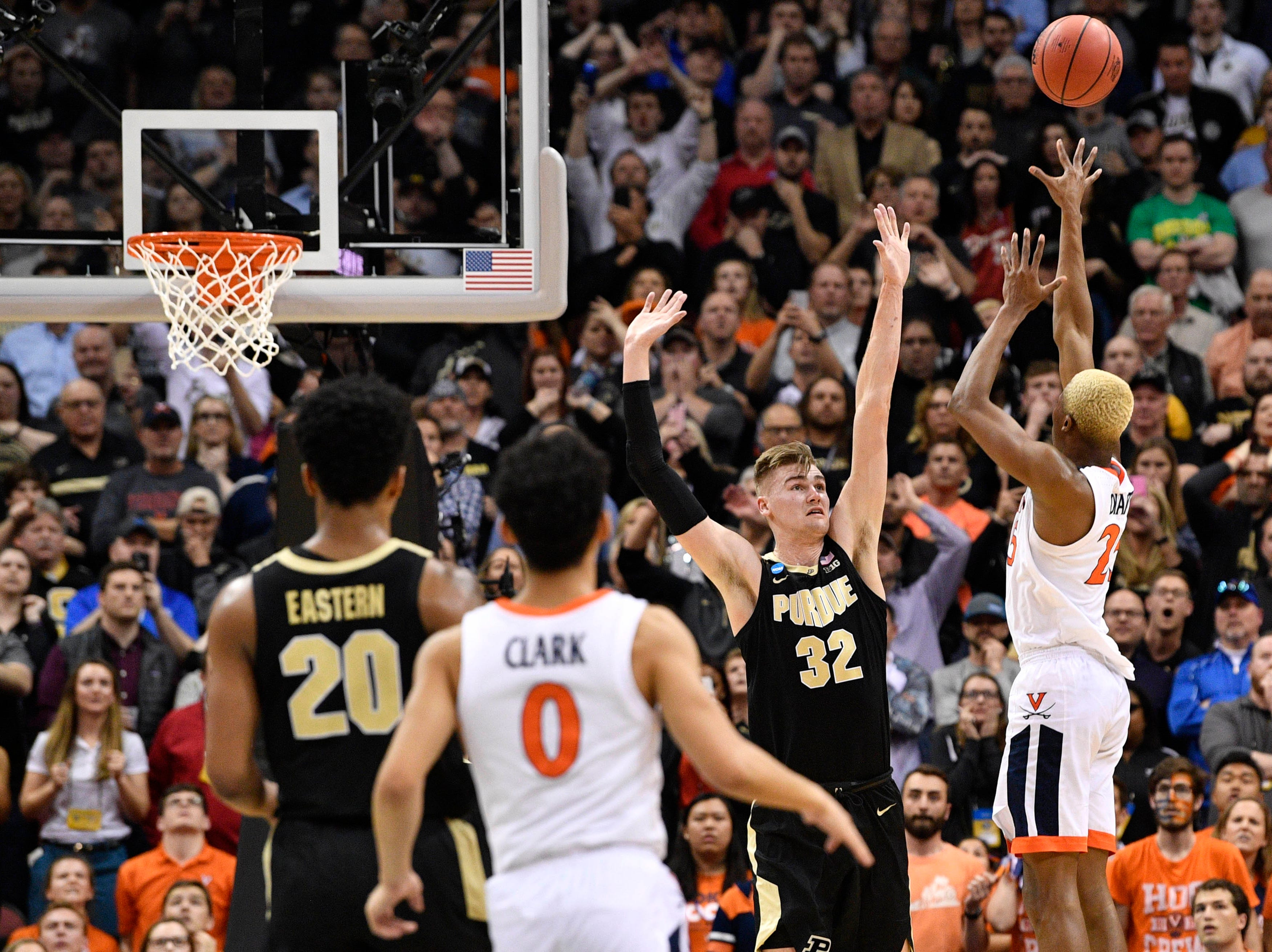 Mar 30, 2019; Louisville, KY, United States; Virginia Cavaliers forward Mamadi Diakite (25) makes a shot over Purdue Boilermakers center Matt Haarms (32) to tie the game as time expires during the second half in the championship game of the south regional of the 2019 NCAA Tournament at KFC Yum Center. Mandatory Credit: Jamie Rhodes-USA TODAY Sports