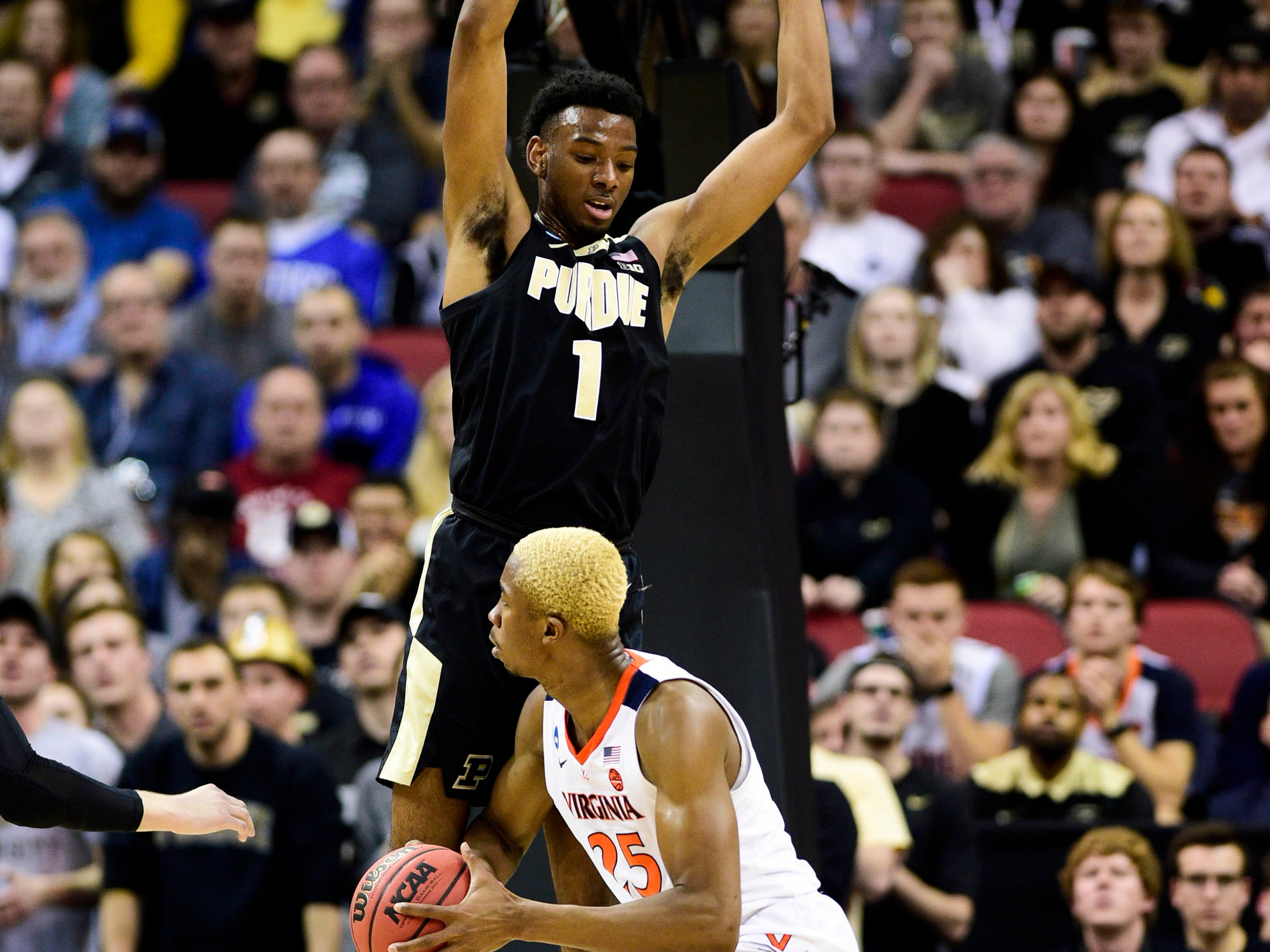 Mar 30, 2019; Louisville, KY, United States; Purdue Boilermakers forward Aaron Wheeler (1) defends Virginia Cavaliers forward Mamadi Diakite (25) during the first half in the championship game of the south regional of the 2019 NCAA Tournament at KFC Yum Center. Mandatory Credit: Thomas J. Russo-USA TODAY Sports