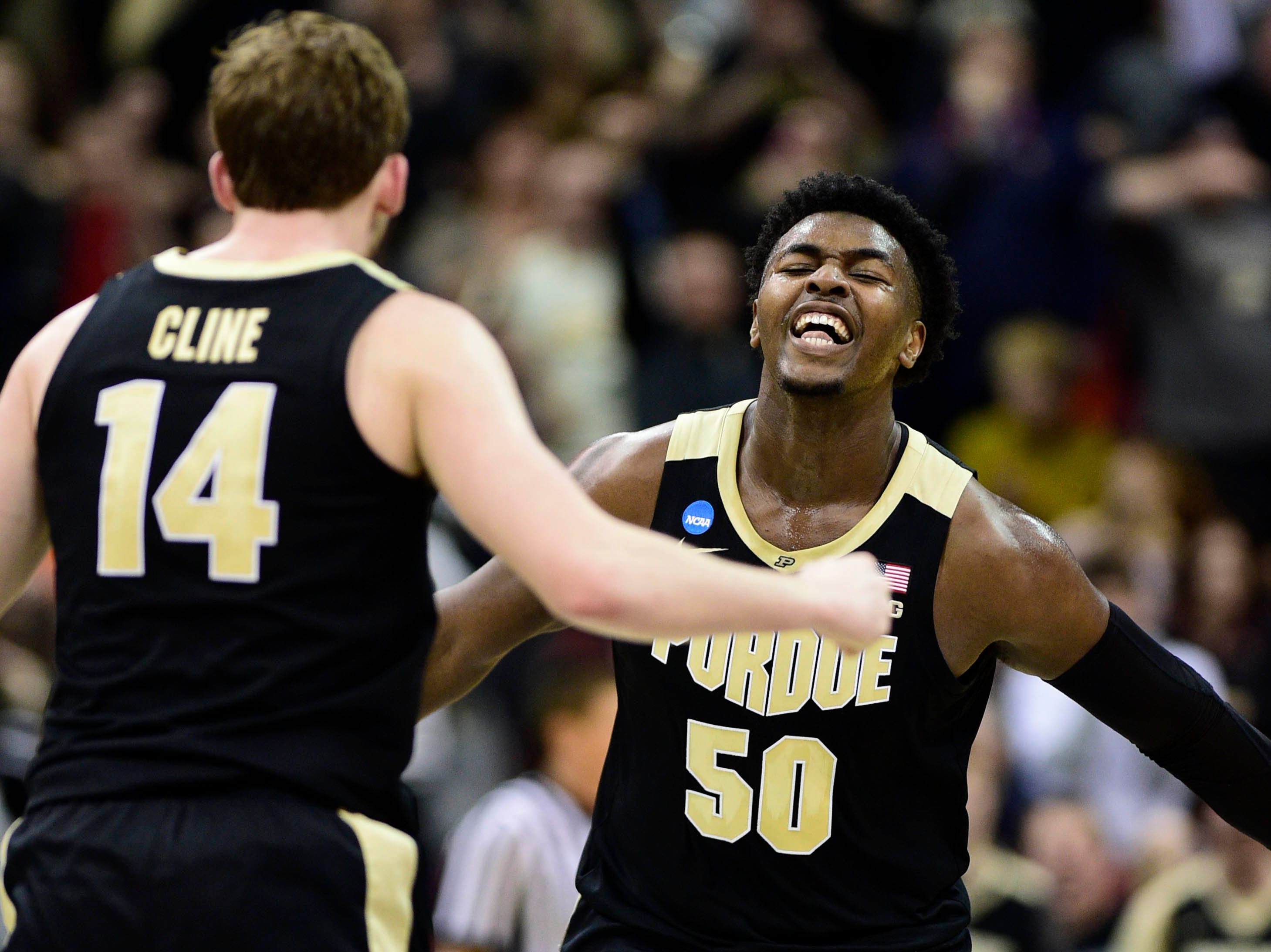 Mar 30, 2019; Louisville, KY, United States; Purdue Boilermakers forward Trevion Williams (50) reacts with guard Ryan Cline (14) during the second half in the championship game against the Virginia Cavaliers of the south regional of the 2019 NCAA Tournament at KFC Yum Center. Mandatory Credit: Thomas J. Russo-USA TODAY Sports