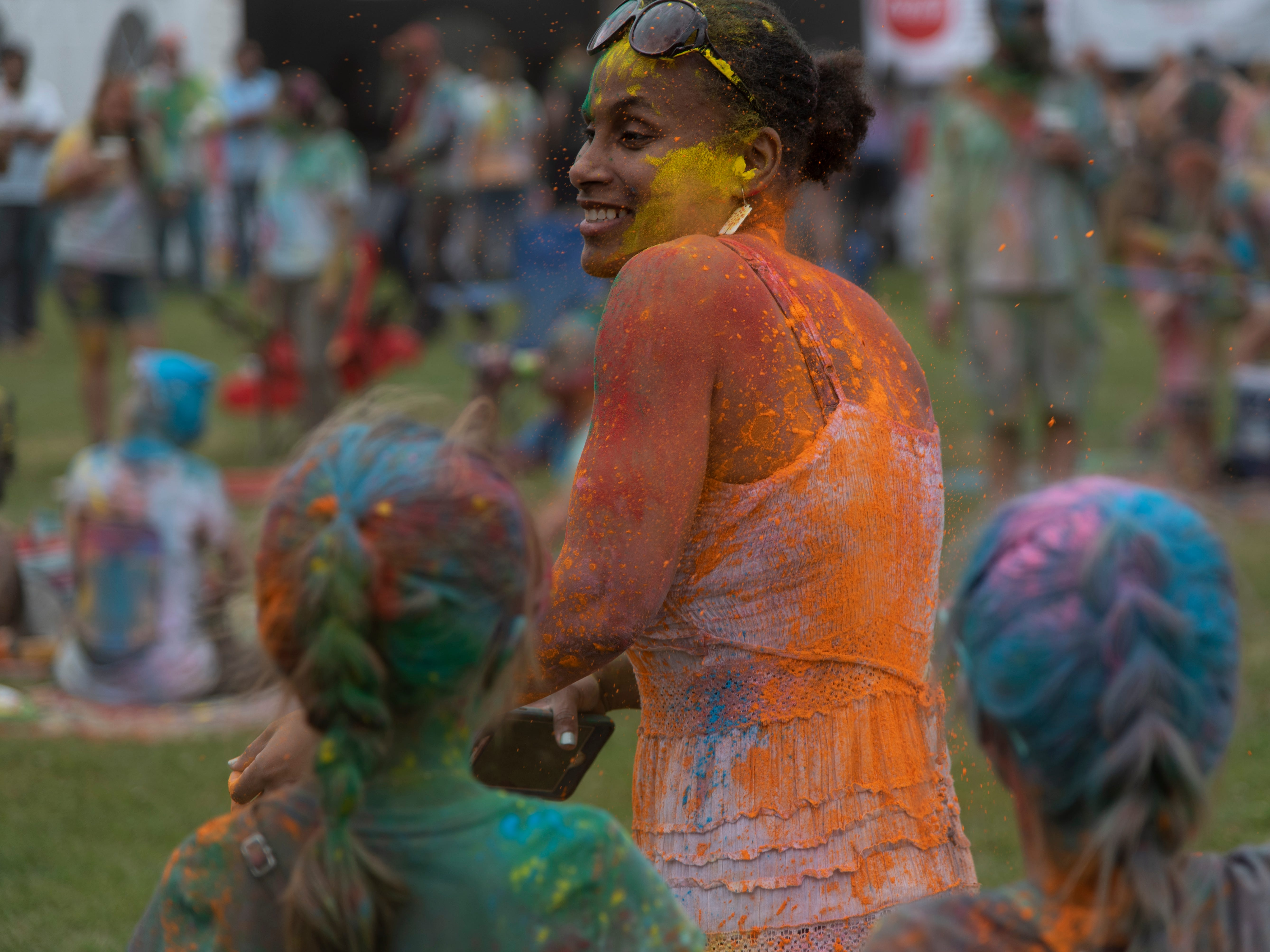 Festival goers celebrate at the ninth annual Holi Festival of Lafayette in Girard Park on Saturday, March 30, 2019.