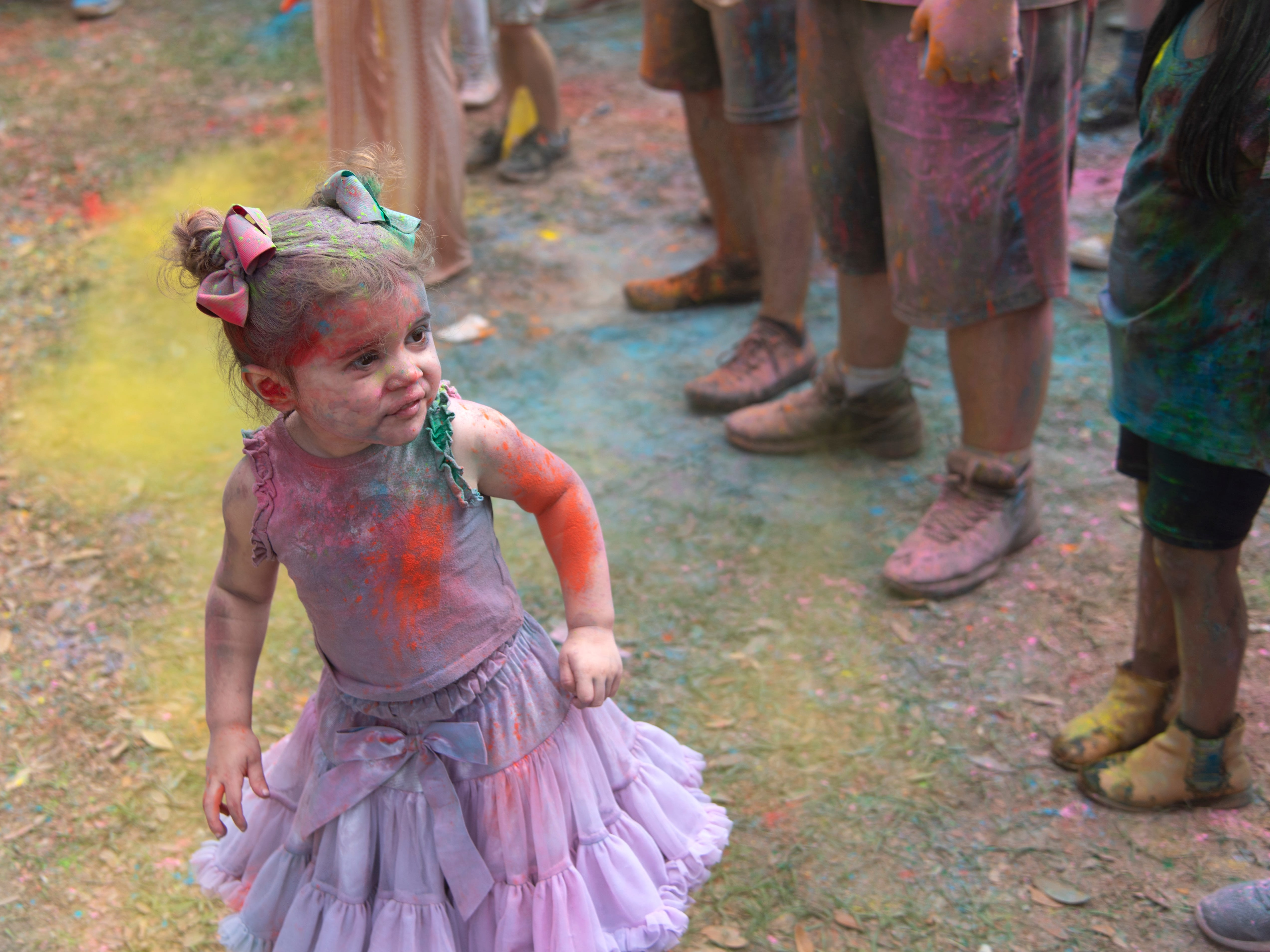 Leslie Cazares, 3, dances to the high-energy music at the ninth annual Holi Festival of Lafayette in Girard Park on Saturday, March 30, 2019.