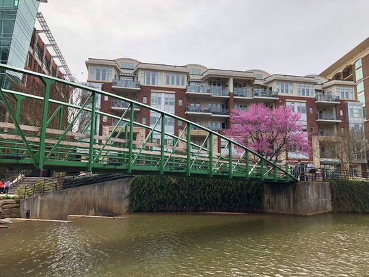 One Acadiana organized a three-day trip to Greenville, South Carolina, and attendees viewed the downtown through a walking tour. The Reedy River runs through downtown Greenville.