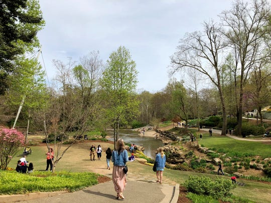 The Reedy River runs through downtown Greenville, South Carolina. A pedestrian bridge overlooks the falls, which are surrounded by green space and trails called Falls Park. One Acadiana organized a three-day trip to Greenville.
