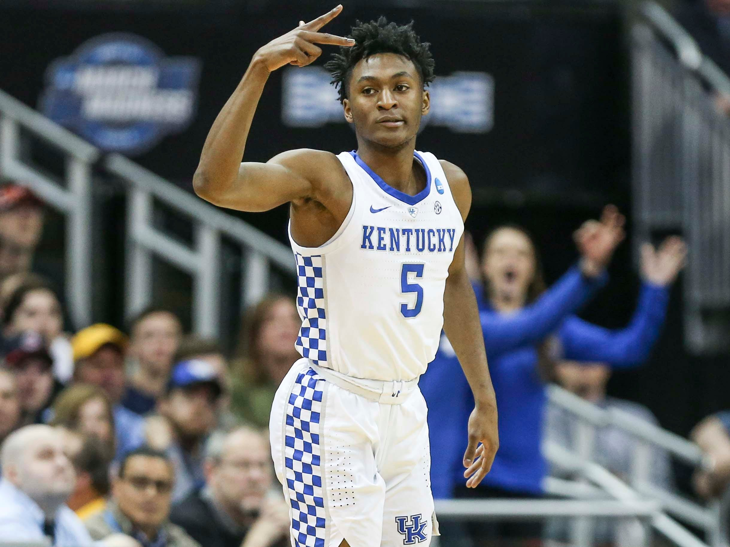 Kentucky's Immanuel Quickley celebrates a three-point shot in the first half against Auburn Sunday aftermnoon in the Elite Eight. March 31, 2019