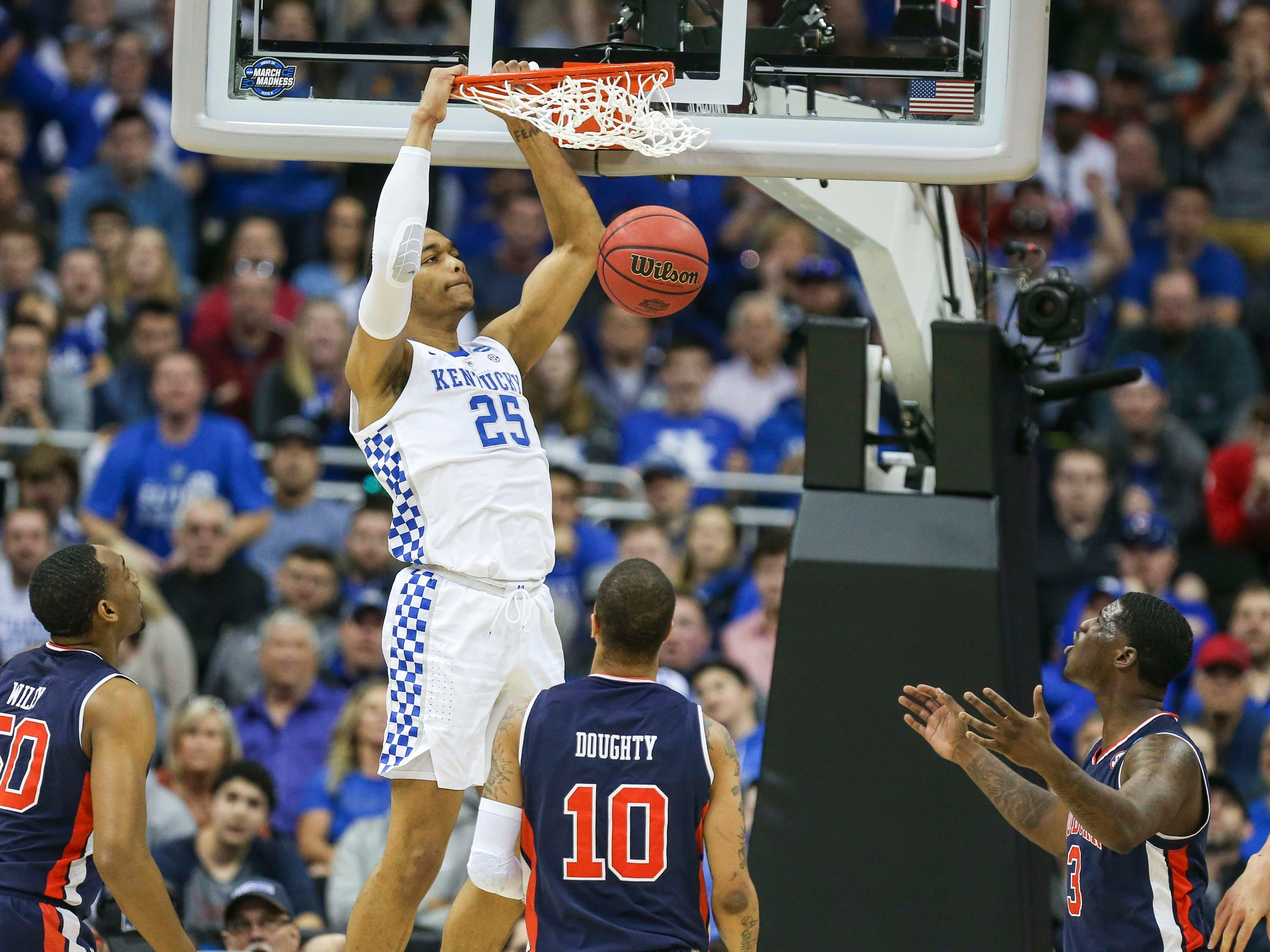 Kentucky's PJ Washington Jr. slams down two in the first half against Auburn Sunday aftermnoon in the Elite Eight. March 31, 2019