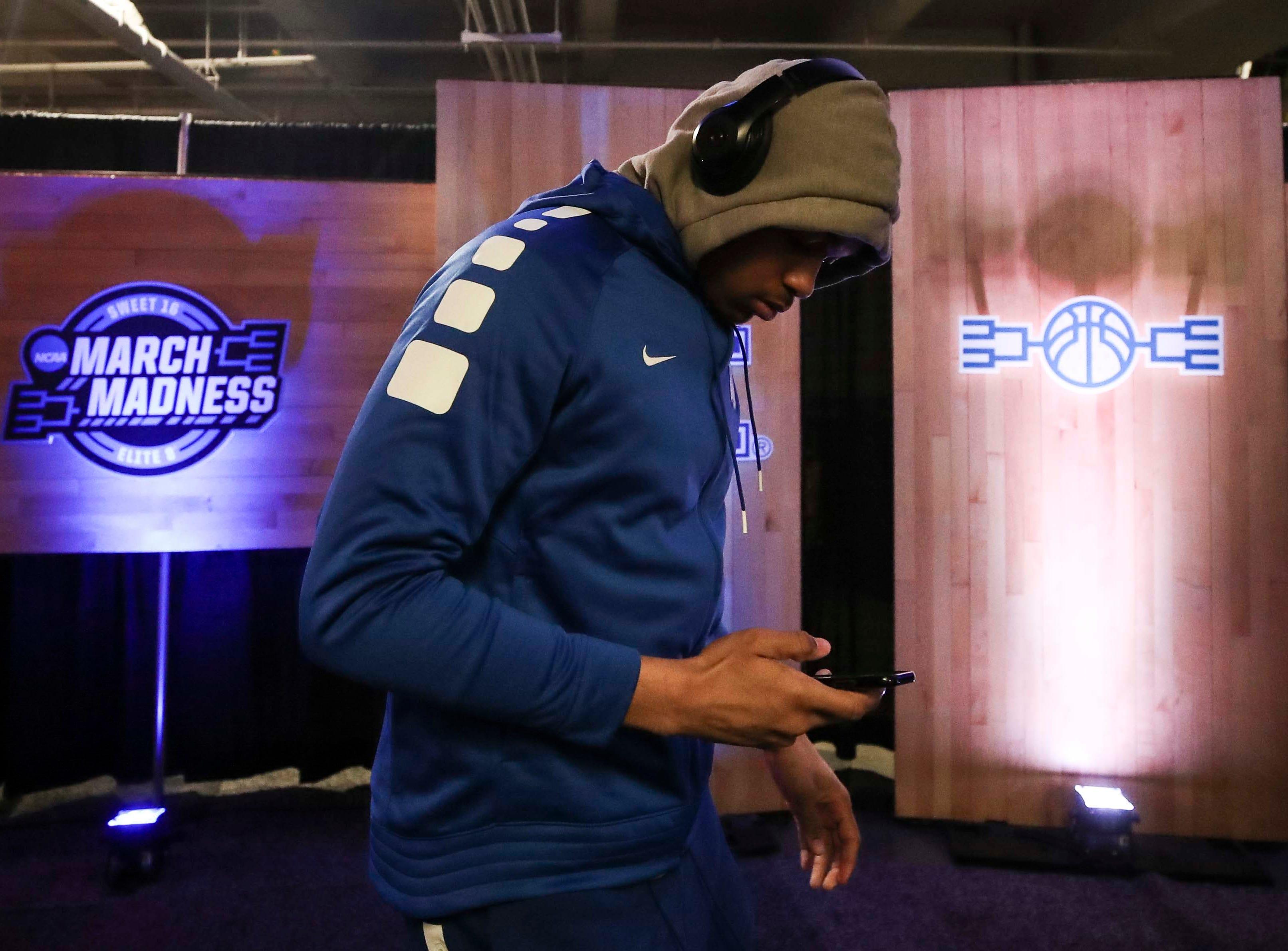 Kentucky player PJ Washington walks towards the locker room at the Sprint Center in Kansas City before game against Auburn. March 31, 2019
