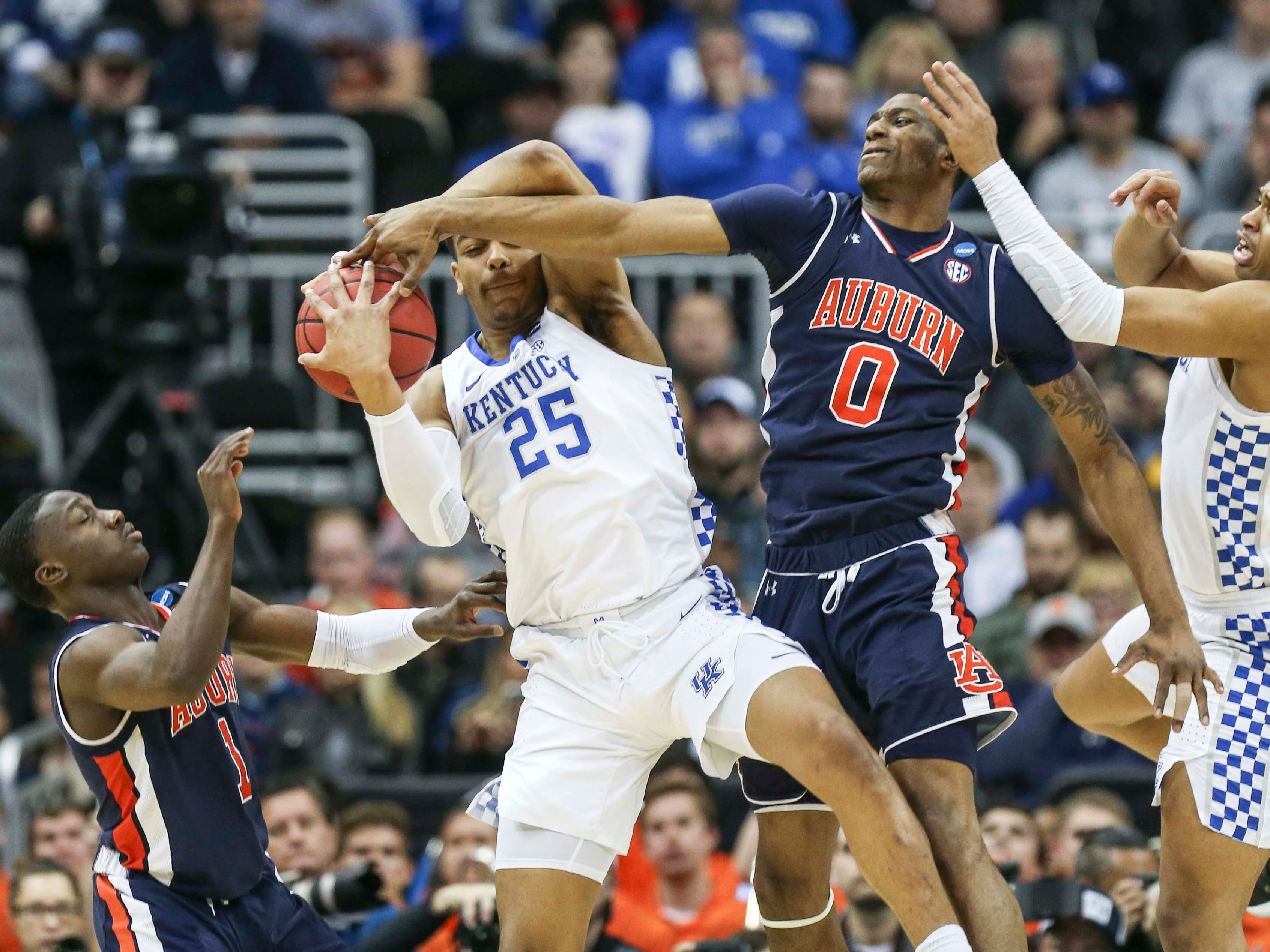 Kentucky's PJ Washington grabs a rebound in the first half against Auburn Sunday aftermnoon in the Elite Eight. March 31, 2019