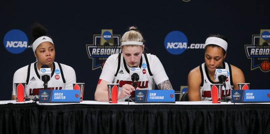(L-R)  U of L's seniors Arica Carter, Sam Fuehring and Asia Durr were somber following their 80-73 loss to UConn during the Elite 8 in Albany, N.Y.
