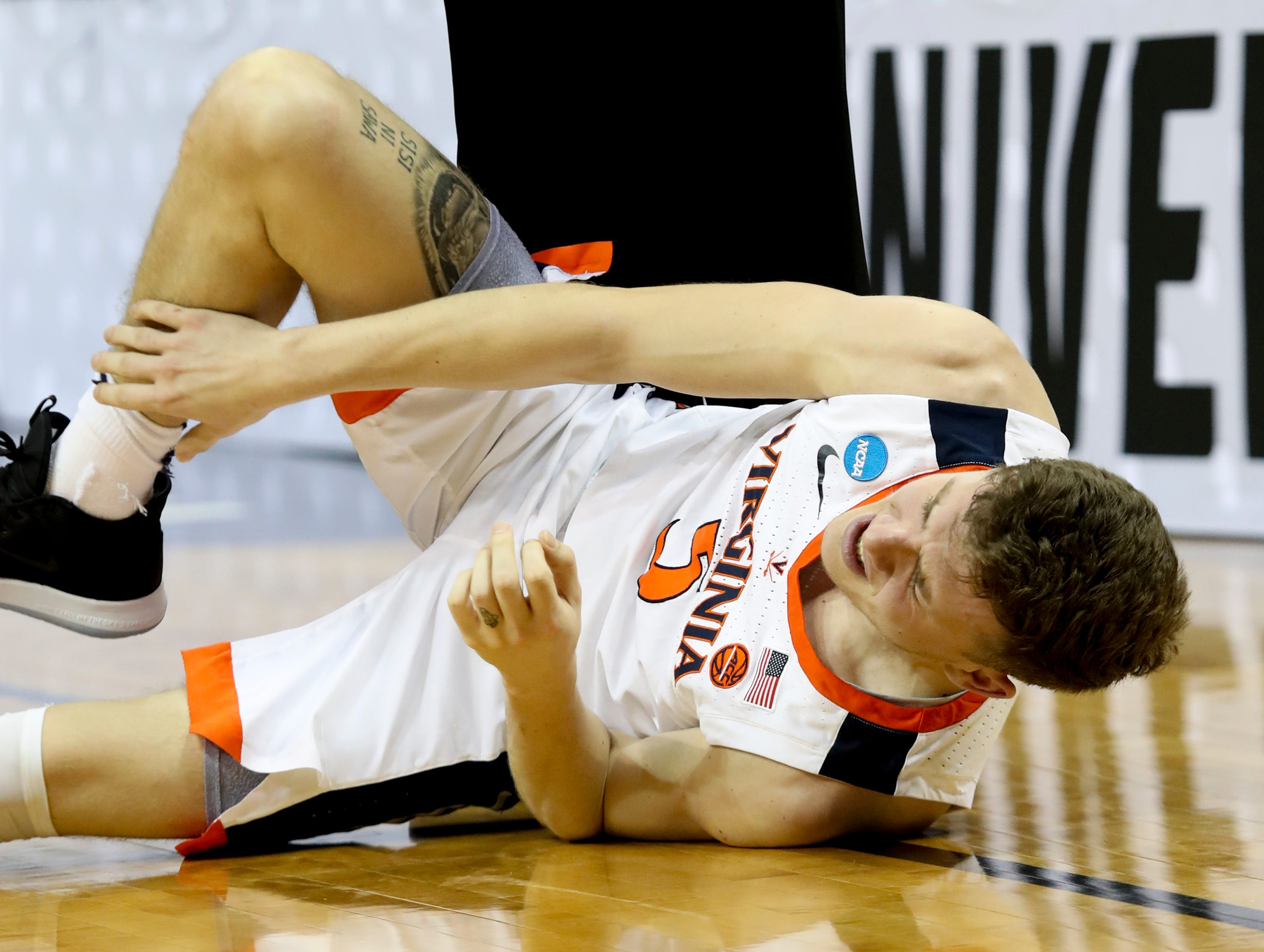 Virginia's Kyle Guy gets hurt against Purdue on March 30 in the NCAA Elite 8.