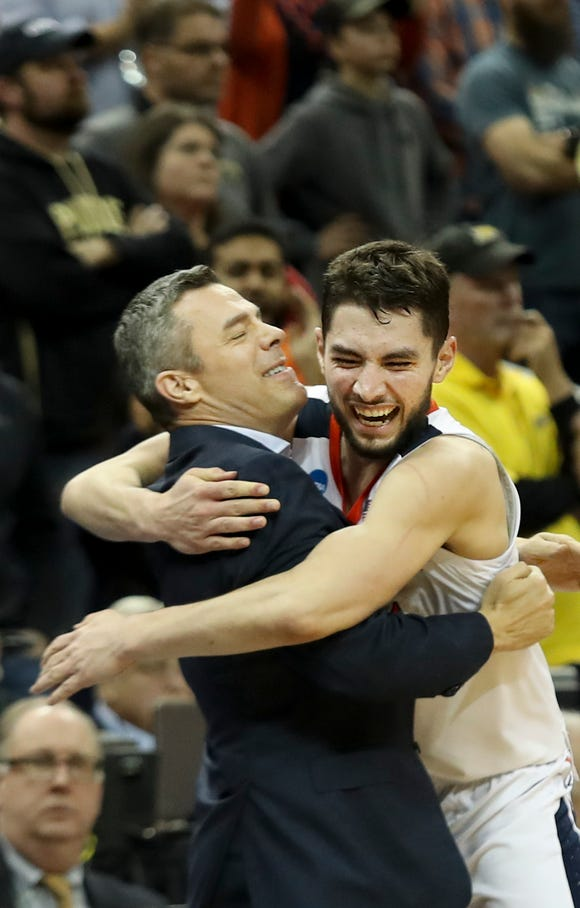Virginia's Ty Jerome hugs Tony Bennett during the celebration as the Cavaliers' beat Purdue on March 30 to advance to the NCAA Final Four.