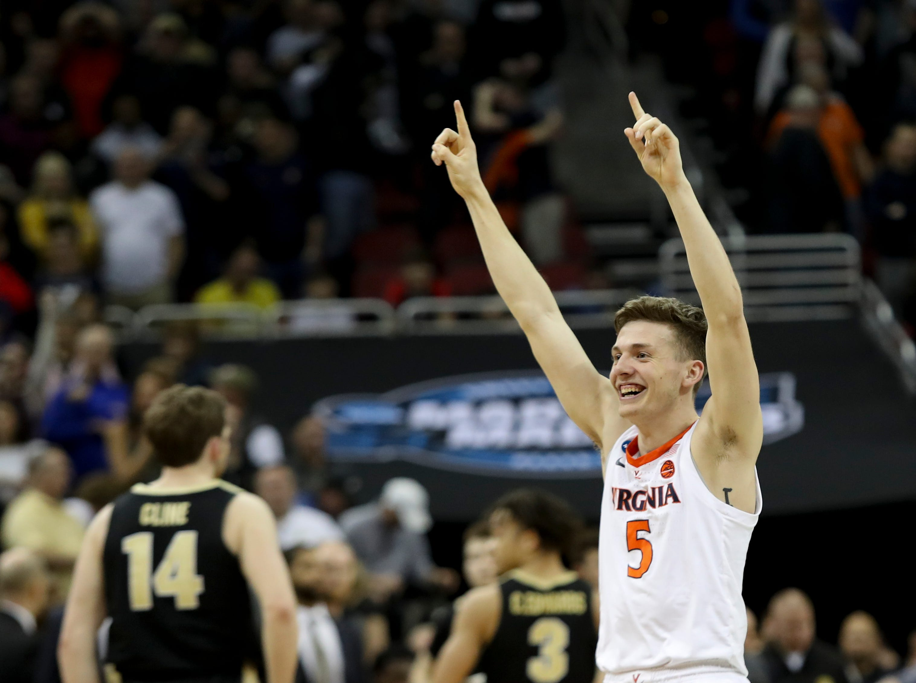 Virginia's Kyle Guy celebrates the Cavaliers' win over Purdue on March 30 to advance to the NCAA Final Four.