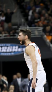 Virginia's Ty Jerome celebrates after knocking down a three against Purdue on March 30 in the NCAA Elite 8.