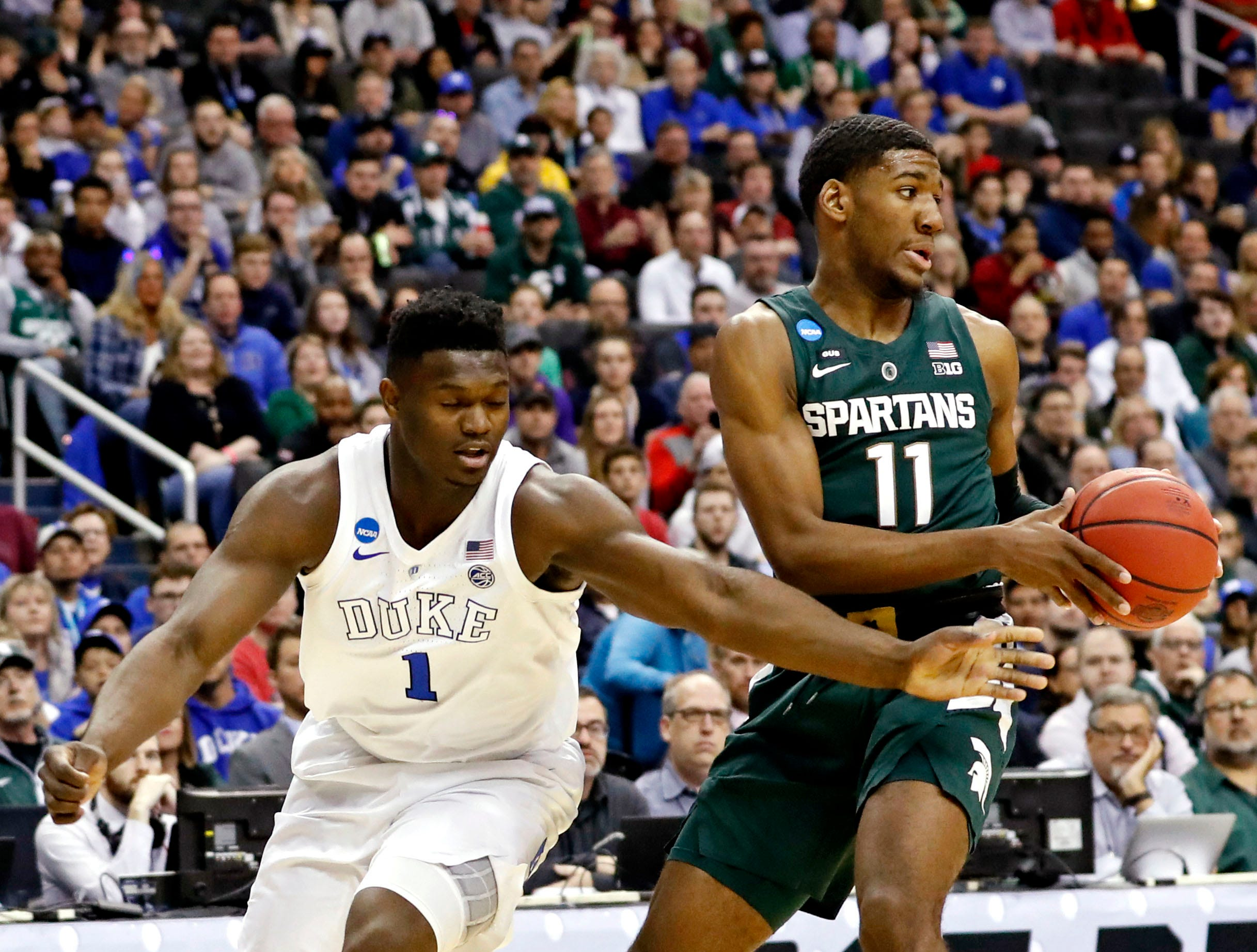 Mar 31, 2019; Washington, DC, USA; Michigan State Spartans forward Aaron Henry (11) handles the ball against Duke Blue Devils forward Zion Williamson (1) during the first half in the championship game of the east regional of the 2019 NCAA Tournament at Capital One Arena. Mandatory Credit: Geoff Burke-USA TODAY Sports