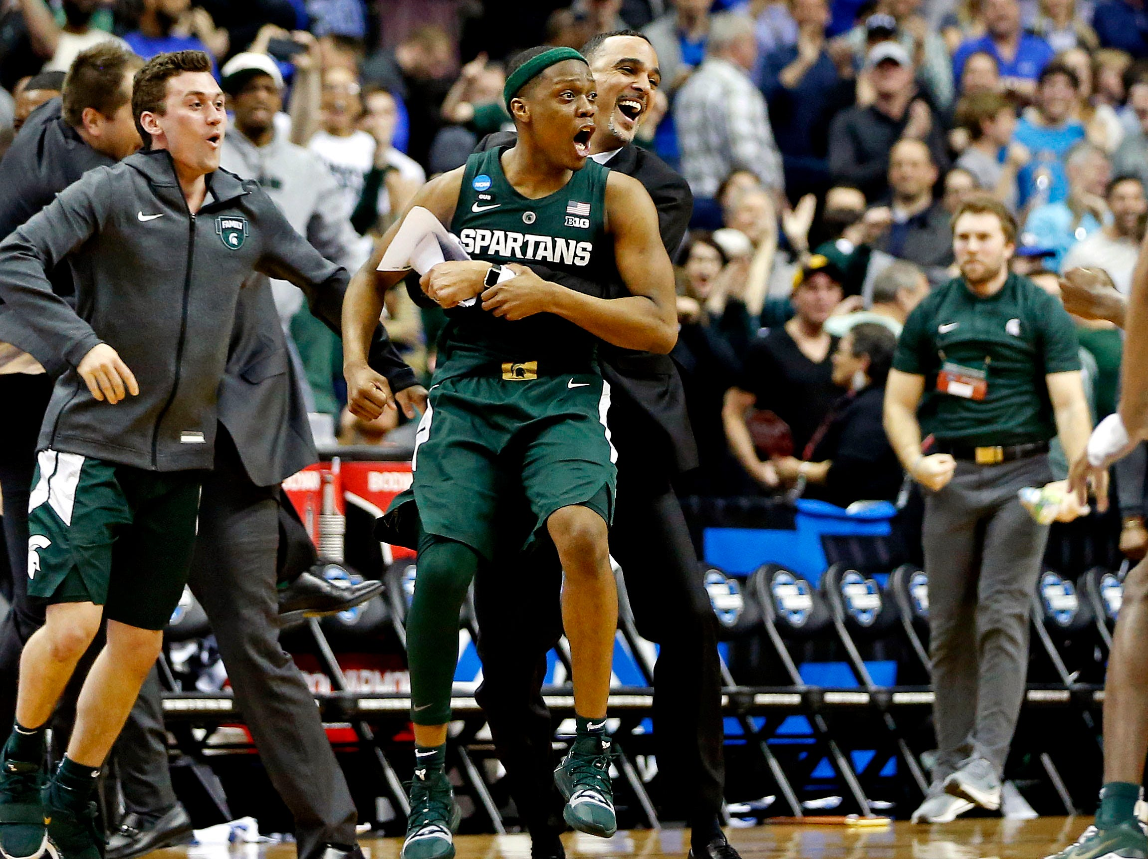 Mar 31, 2019; Washington, DC, USA; Michigan State Spartans guard Cassius Winston (5) celebrates after beating the Duke Blue Devils in the championship game of the east regional of the 2019 NCAA Tournament at Capital One Arena. Mandatory Credit: Amber Searls-USA TODAY Sports