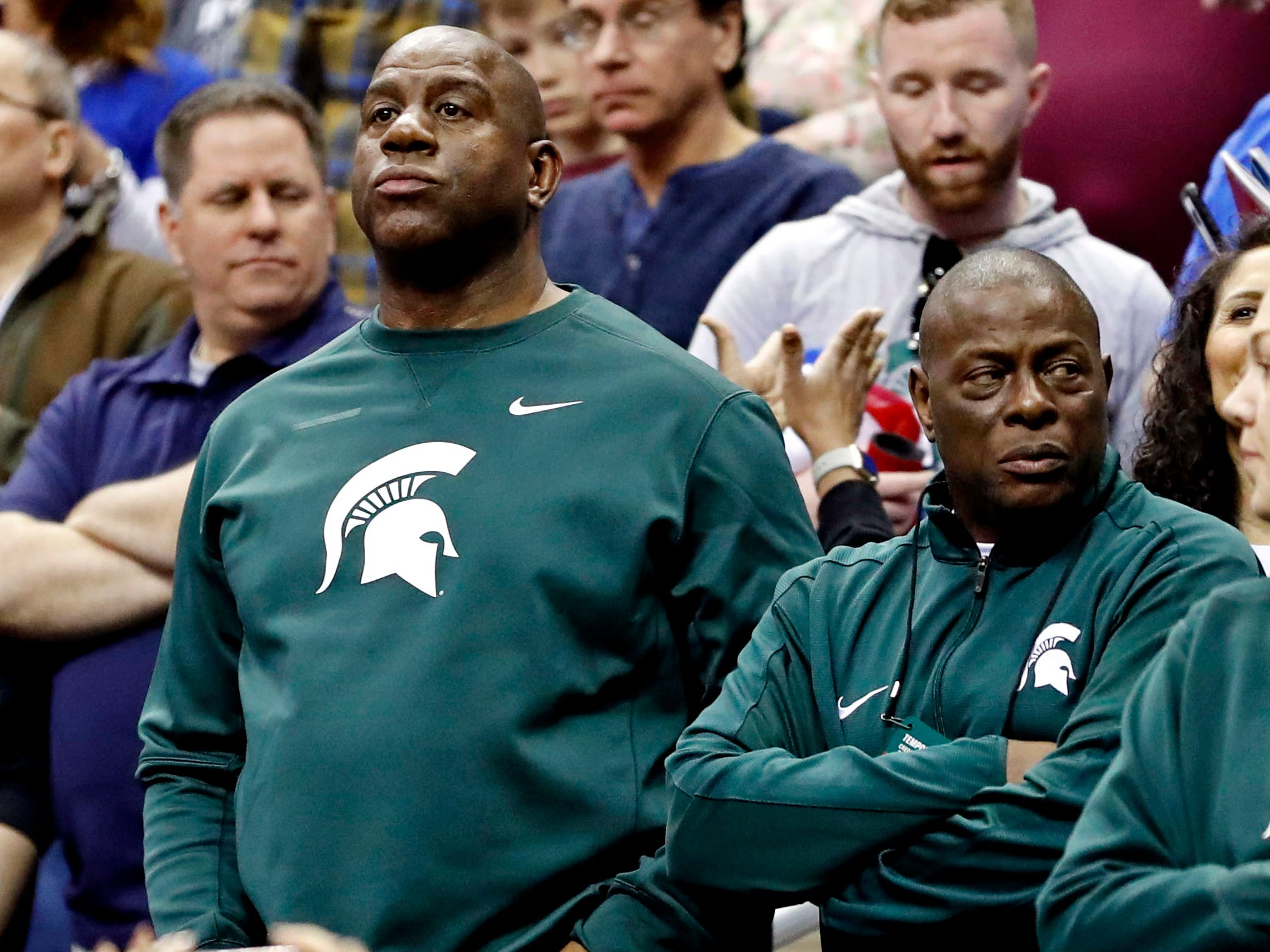 Michigan State Spartans former player Magic Johnson watches during the first half in the championship game of the east regional of the 2019 NCAA Tournament against the Duke Blue Devils at Capital One Arena.