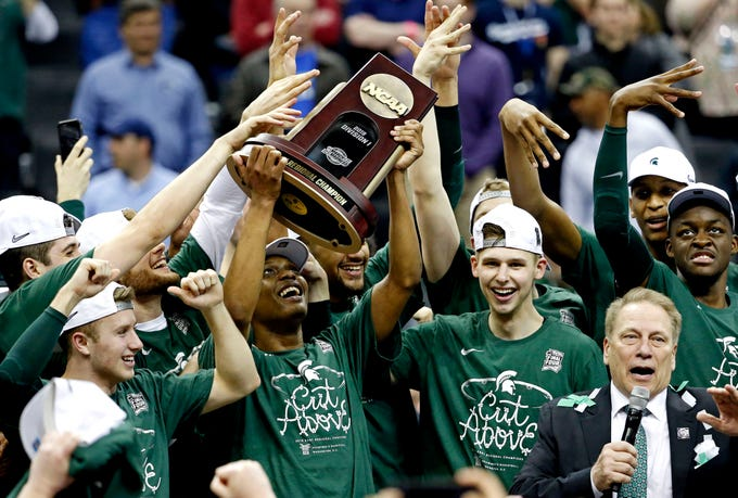 Mar 31, 2019; Washington, DC, USA; Michigan State Spartans guard Cassius Winston (5) and the Michigan State Spartans celebrating beating the Duke Blue Devils in the championship game of the east regional of the 2019 NCAA Tournament at Capital One Arena. Mandatory Credit: Amber Searls-USA TODAY Sports